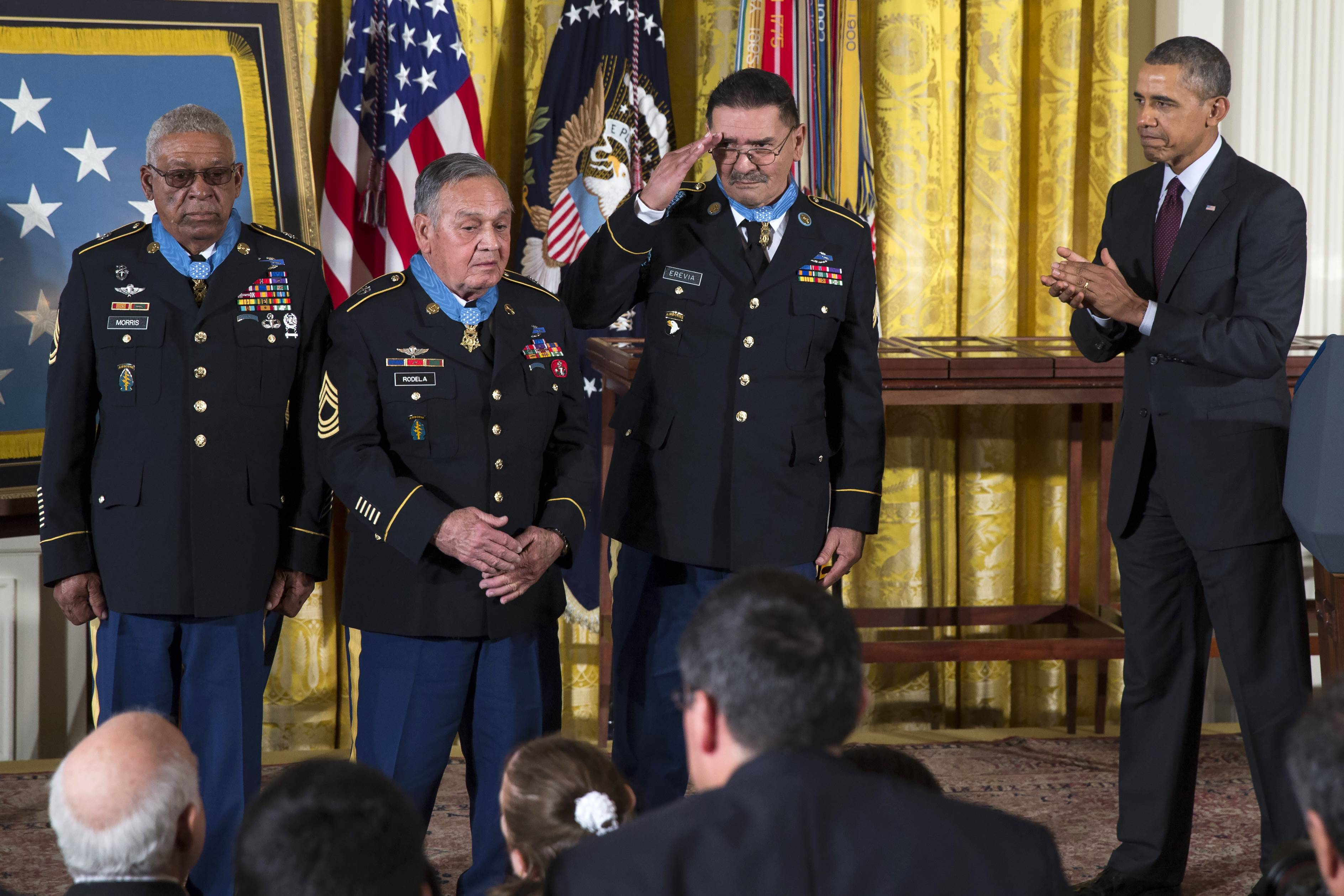 From left, Staff Sgt. Melvin Morris, Sgt. First Class Jose Rodela and Spc. Santiago J. Erevia are applauded by President Barack Obama, right, after being awarded the Medal of Honor during a ceremony at the White House Tuesday. Obama awarded 24 veterans the Medal of Honor for conspicuous gallantry in recognition of their valor during major combat operations in World War II, Korean War and Vietnam War.