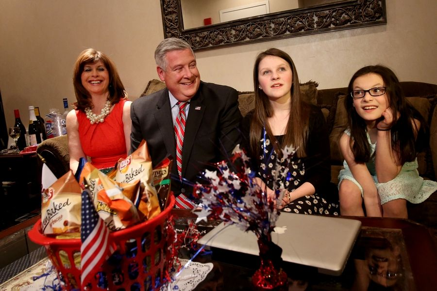 Kirk Dillard awaits results in the race for governor at a banquet hall in Downers Grove Tuesday with his wife, Stephanie, and daughters Emma, 12, and Ava, 10, at far right.
