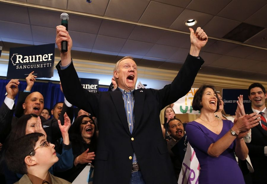 Businessman Bruce Rauner, left, and his wife Diana, right, celebrate with supporters Rauner becoming the Republican gubernatorial candidate after defeating the field of State Treasurer Dan Rutherford, State Sen. Kirk Dillard, and State Sen. Bill Brady, Tuesday, March 18, 2014, in Chicago.