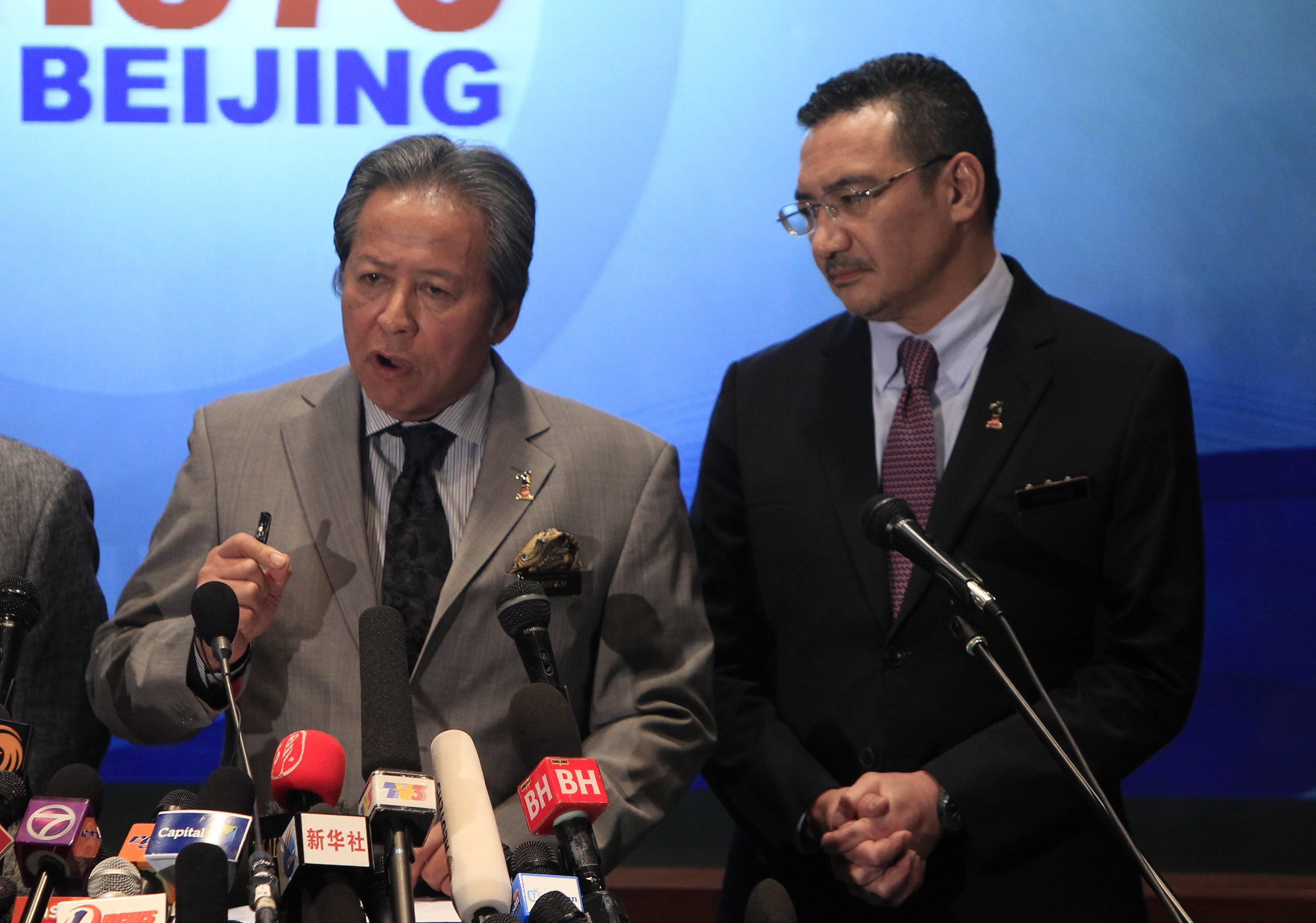Malaysian Foreign Minister Anifah Aman, left, speaks as Malaysian acting Transport Minister Hishammuddin Hussein listens during a press conference at a hotel in Sepang, Malaysia, Tuesday, March 18, 2014.
