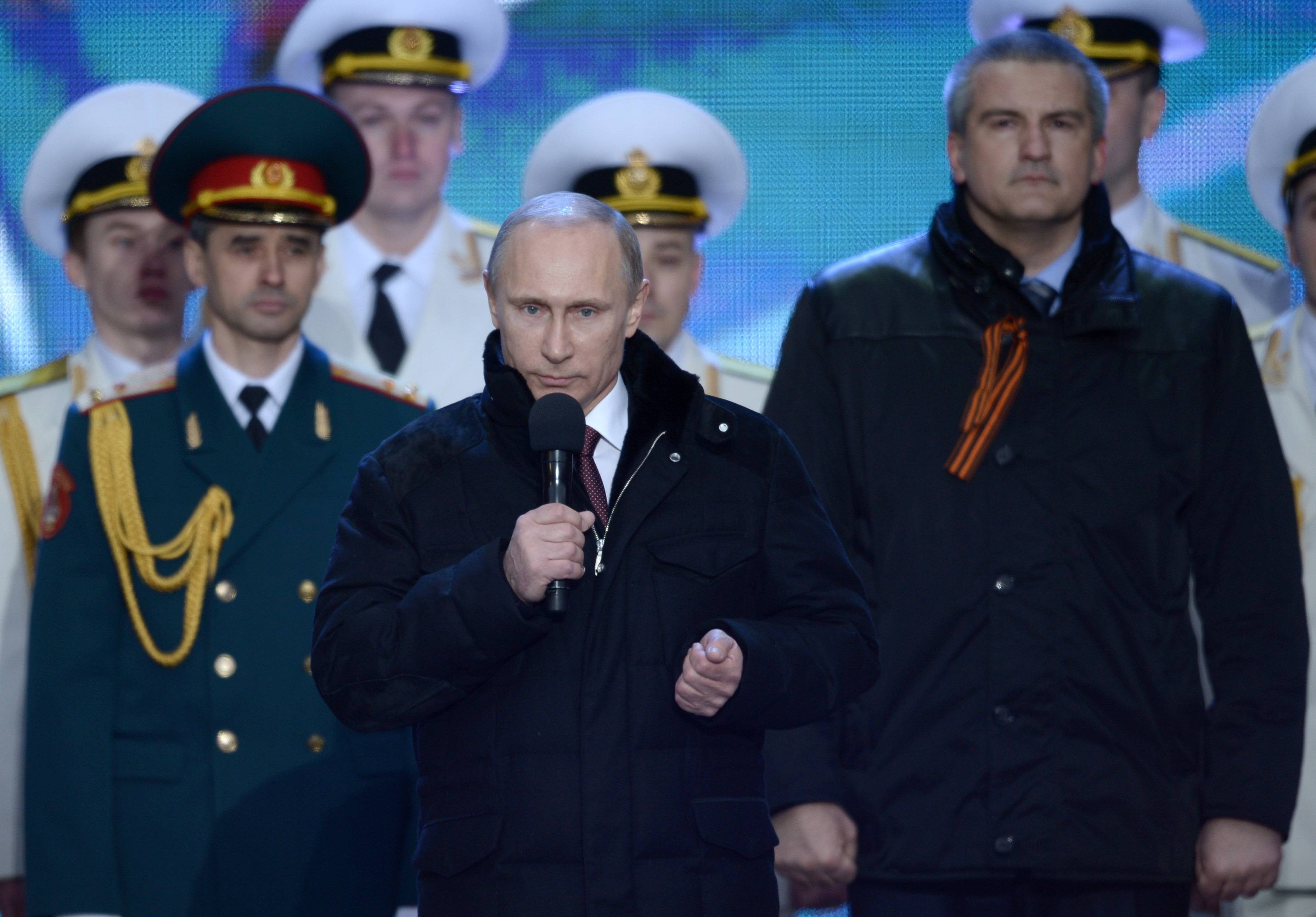 Russian President Vladimir Putin speaks at a rally in support of Crimea joining Russia, in Red Square in Moscow, Tuesday.