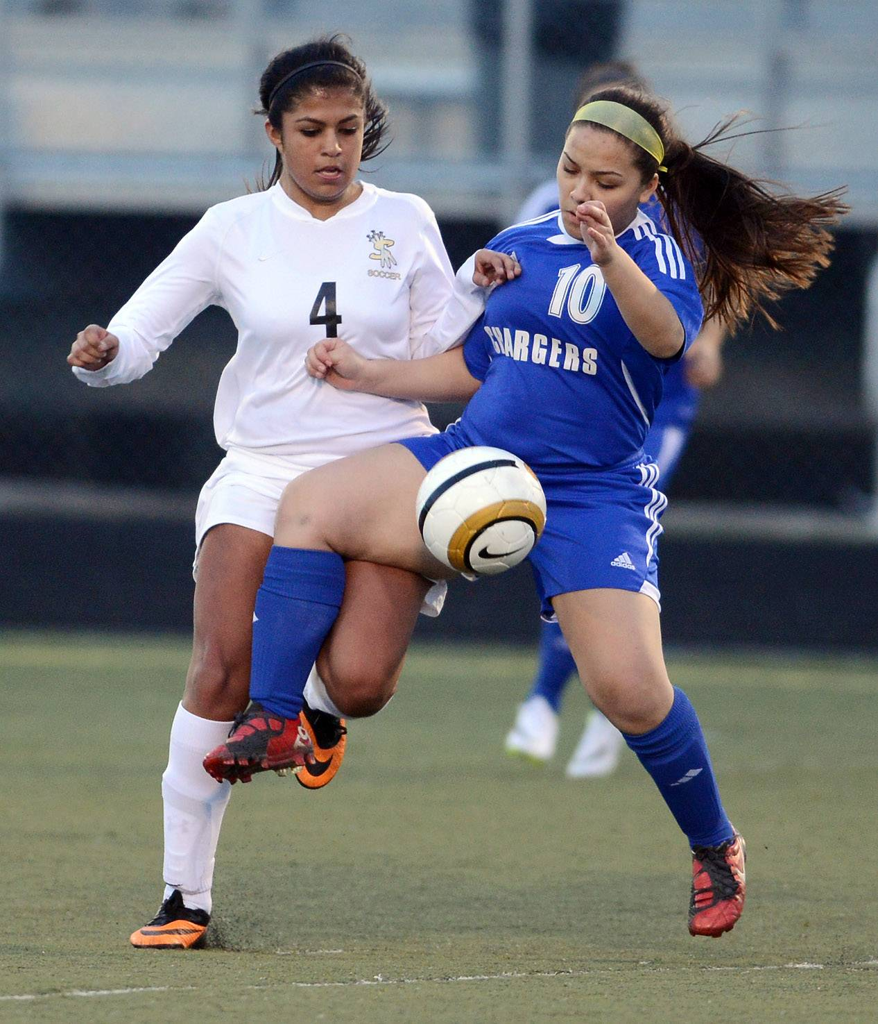 Streamwood's Cassandra Adan (4) and Dundee-Crown's Heily Ramirez (10) battle for the soccer ball during Tuesday's game in Streamwood.