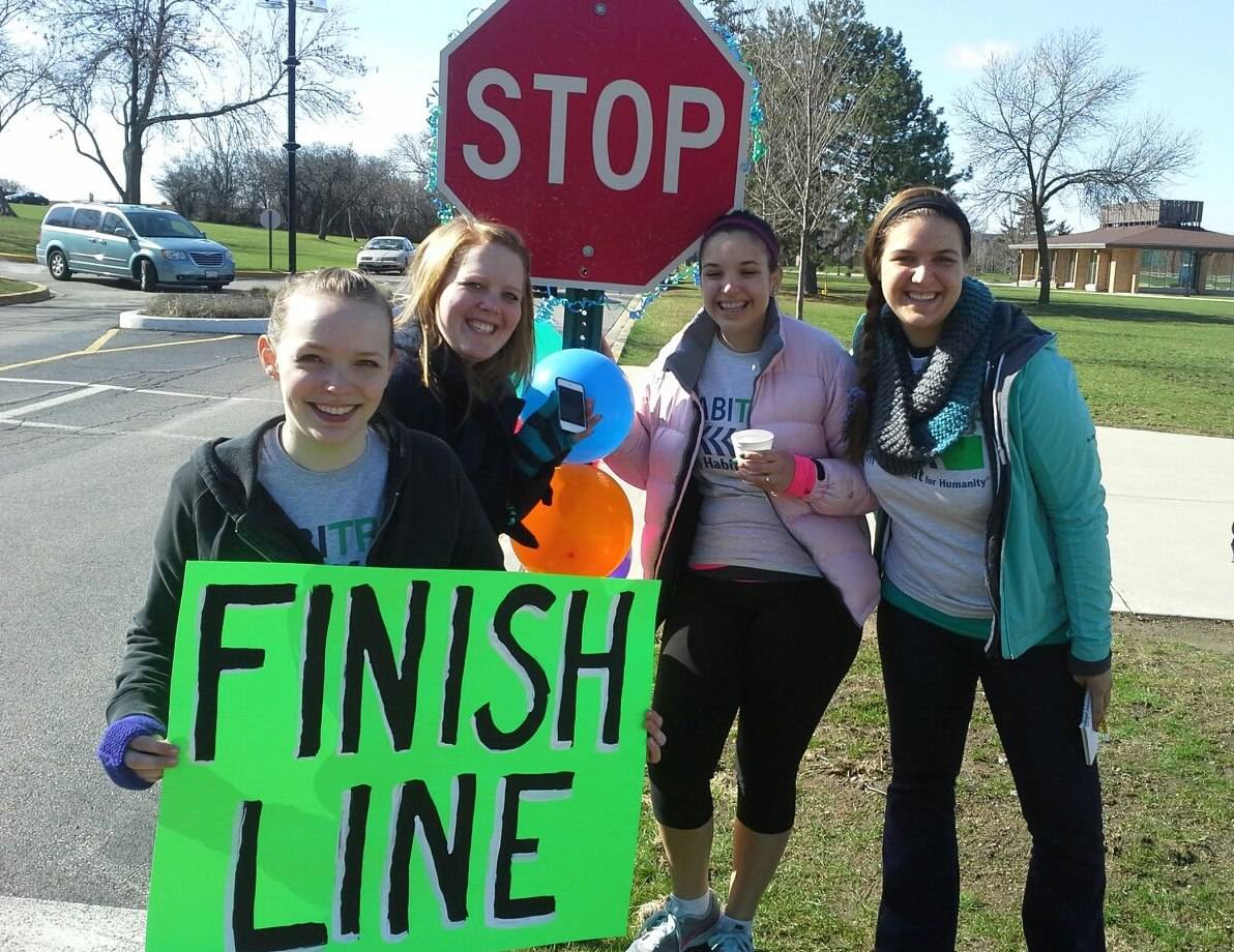 Trinity International University students greet Habitrot 5K Runners at the finish line of last year's event, on the Trinity Campus in Deerfield.Jessa Ter Beest (Trinity Student, BA '13, Elementary Ed.)