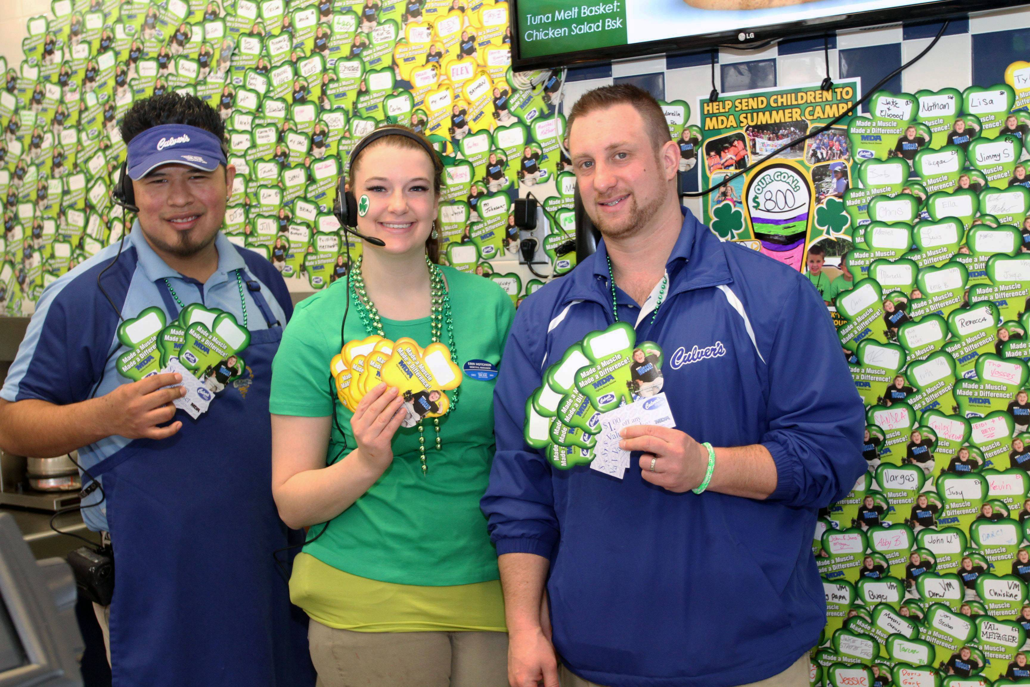 Culver's of Palatine owner Zach Steffens is joined by Erin Hotchkin and Cesar Reyes as they display countless shamrocks supporting MDA.