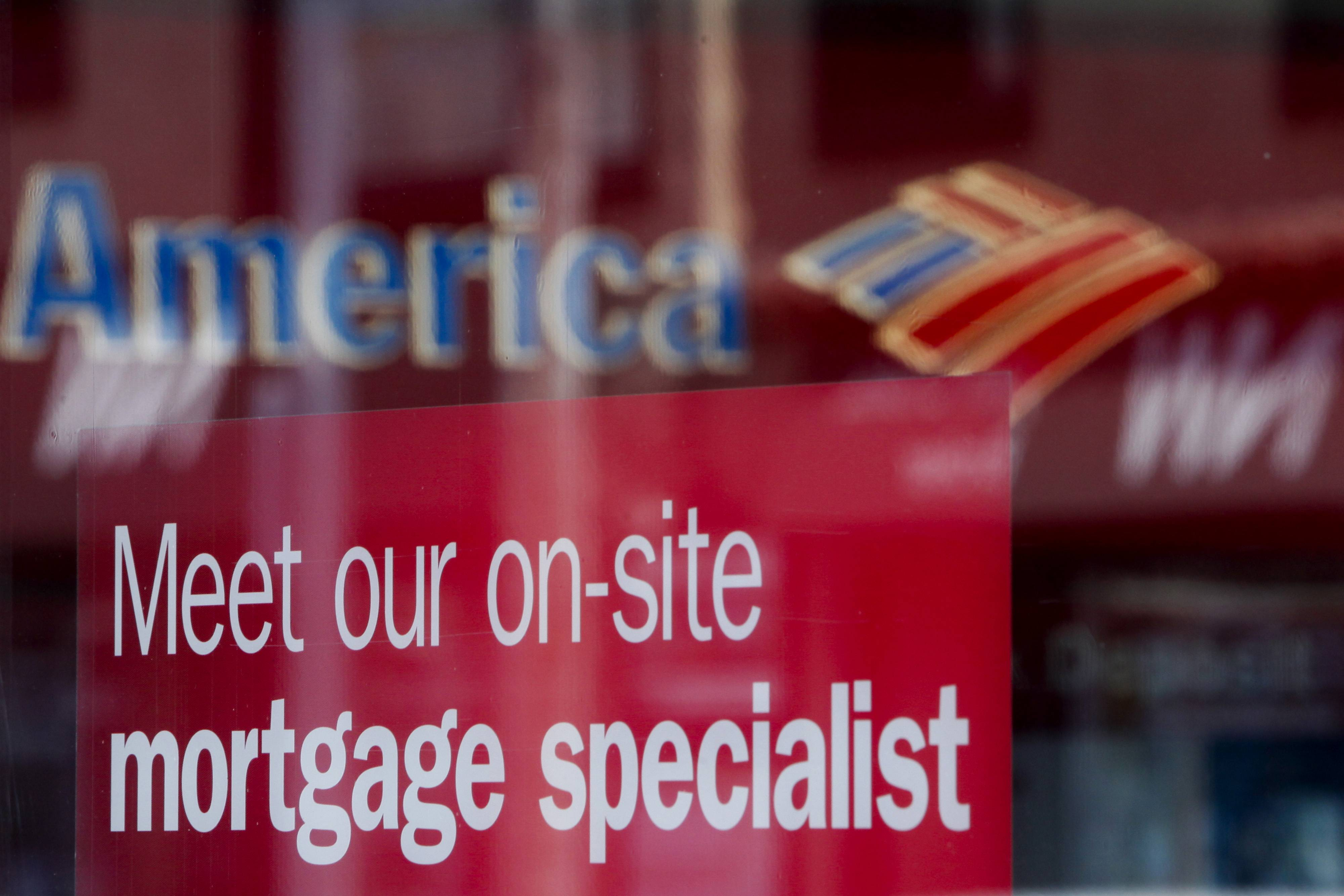 The nation's four biggest banks slashed billions of dollars from mortgages and other debts, enough to satisfy their obligations under a national mortgage settlement that stemmed from so-called robo-signing.