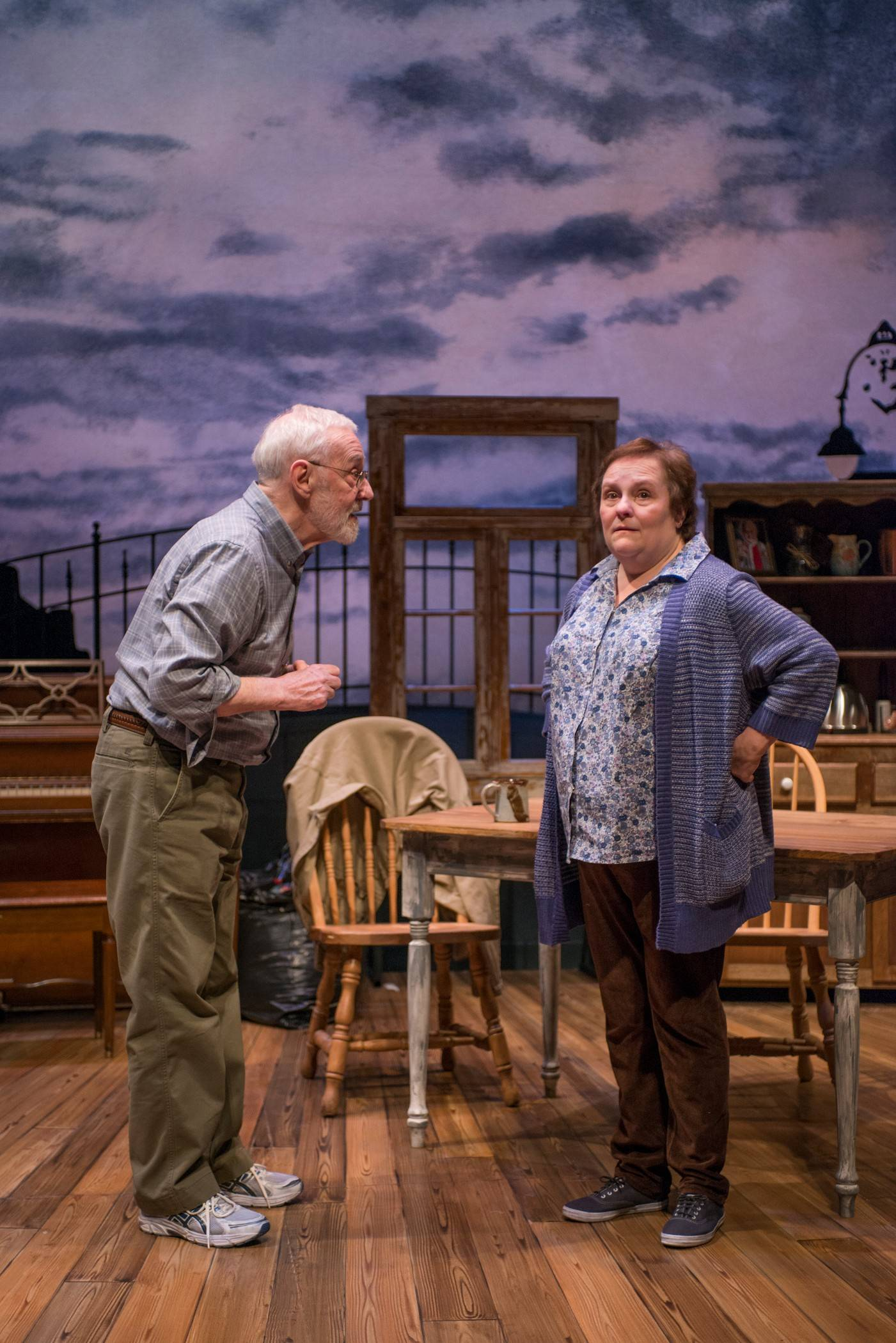 "Self-described cat person Betty (Penny Slusher) brings a smile to the face of grieving dog-lover Dan (John Mahoney) in Christian O'Reilly's ""Chapatti,"" in its world premiere at Northlight Theatre."