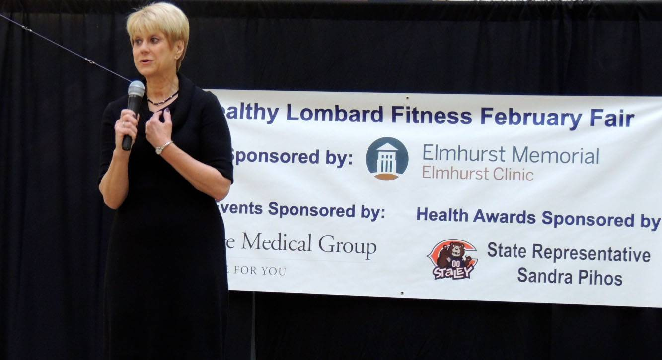 Healthy Lombard founder Jay Wojcik speaks during the organization's annual Fitness February Fair. Wojcik is in the running for a $30,000 grant that could be awarded to the nonprofit group by Health Mart Pharmacies.