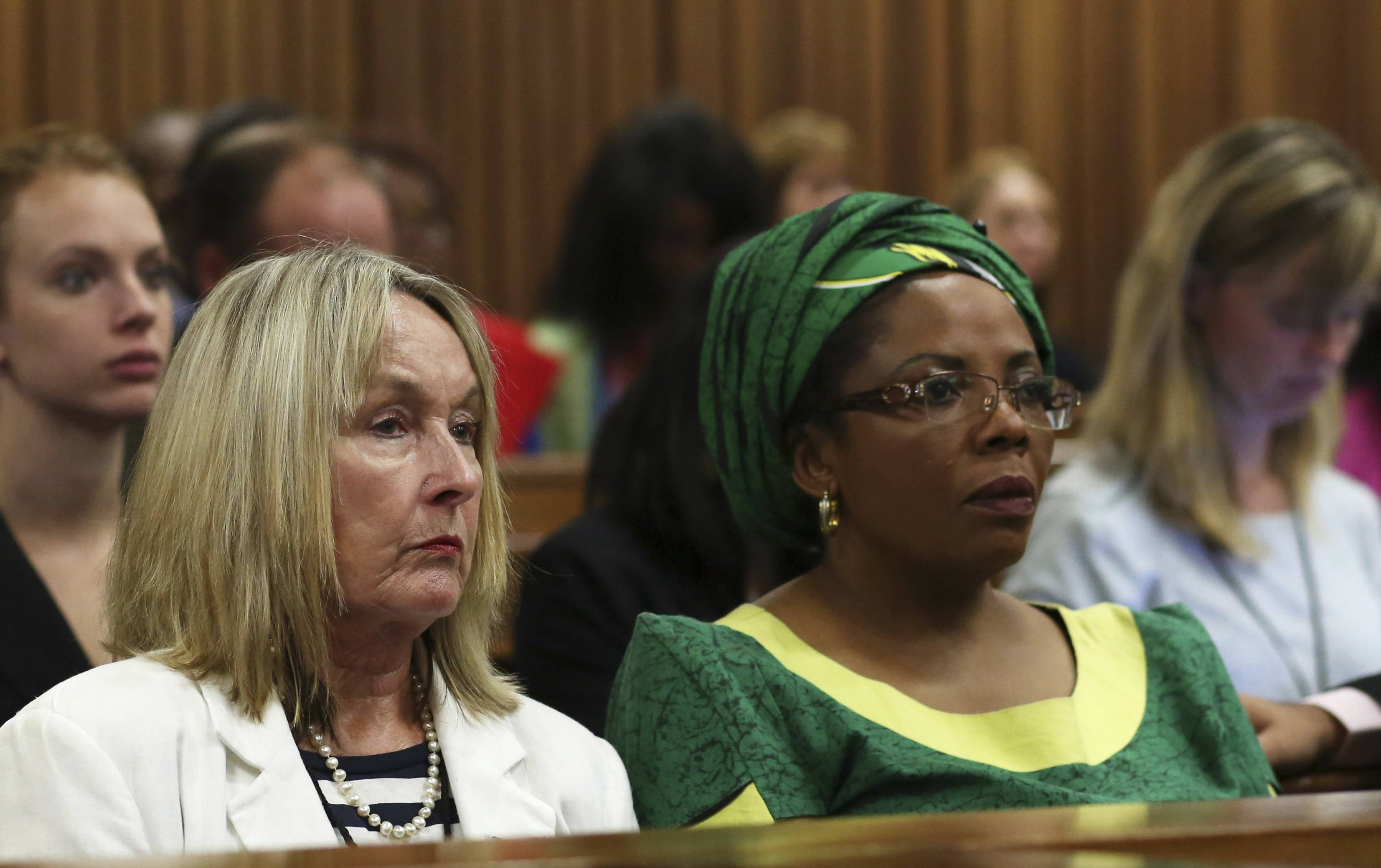 June Steenkamp, mother of Reeva Steenkamp, left, sits with African National Congress Women's League spokesperson Jackie Mofokeng, right, during Oscar Pistorius' trial at the high court in Pretoria, South Africa, Wednesday. Pistorius is charged with murder for the shooting death of his girlfriend Reeva Steenkamp on Valentine's Day in 2013.