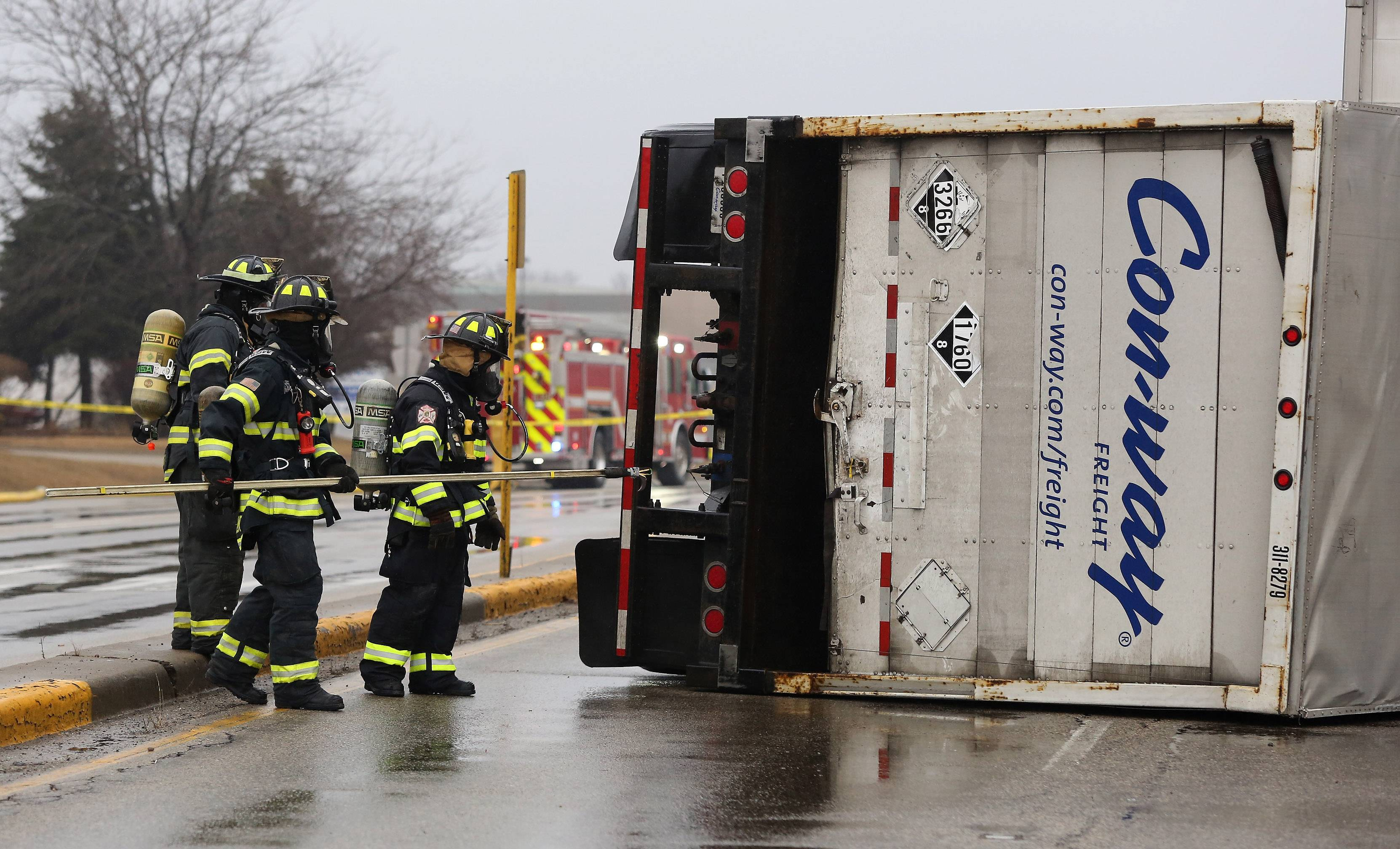 The Lake County Hazmat team test an overturned semitrailer for chemical exposure due to corrosive cleaning materials that spilled inside at Route 60 and Butterfield Road in Vernon Hills. The Wednesday morning accident caused major traffic delays during morning rush hour.