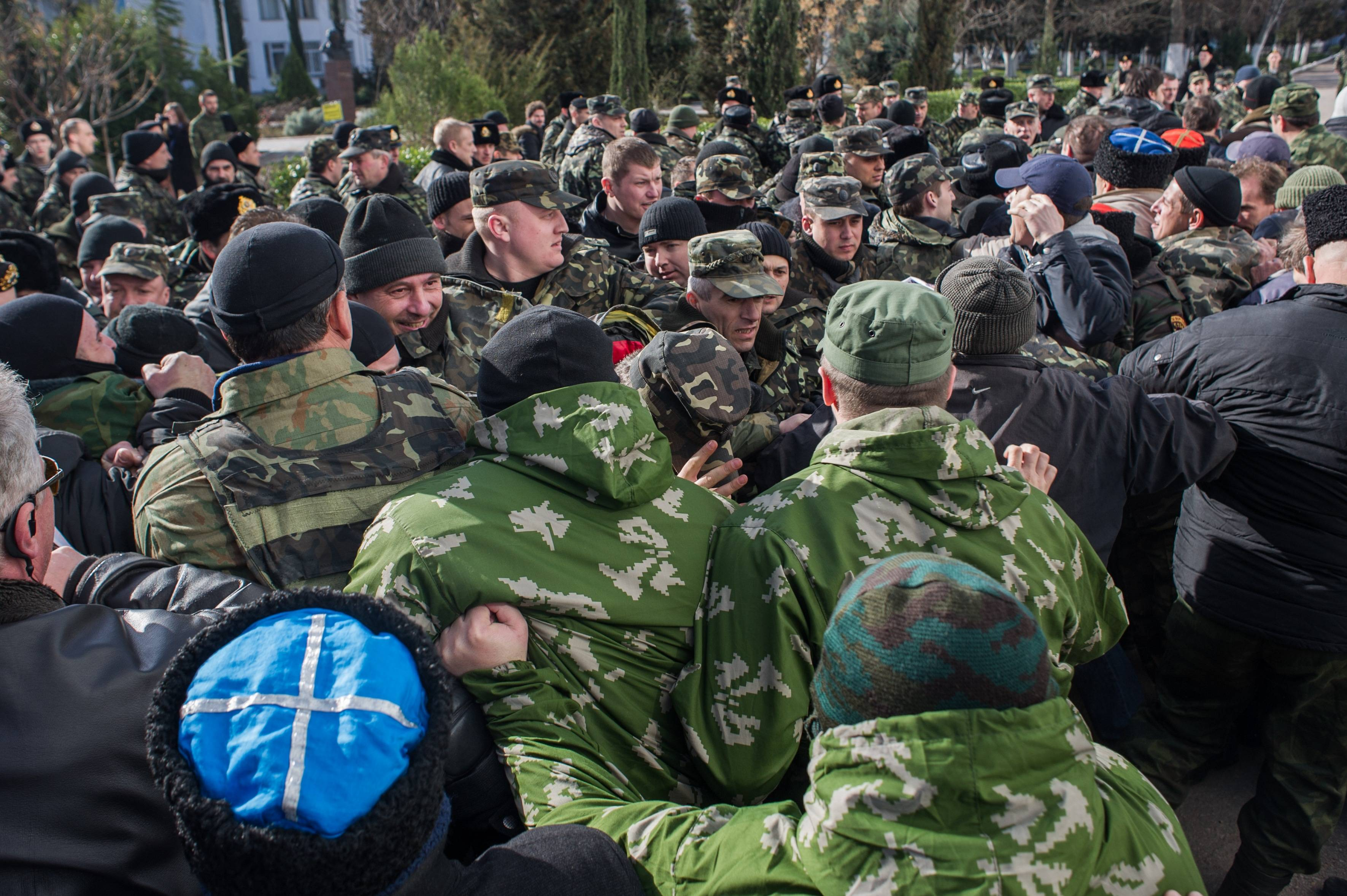 Crimean self-defense forces scuffle with Ukrainian servicemen outside the Ukrainian Navy headquarters in Sevastopol, Crimea, Wednesday, March 19, 2014.