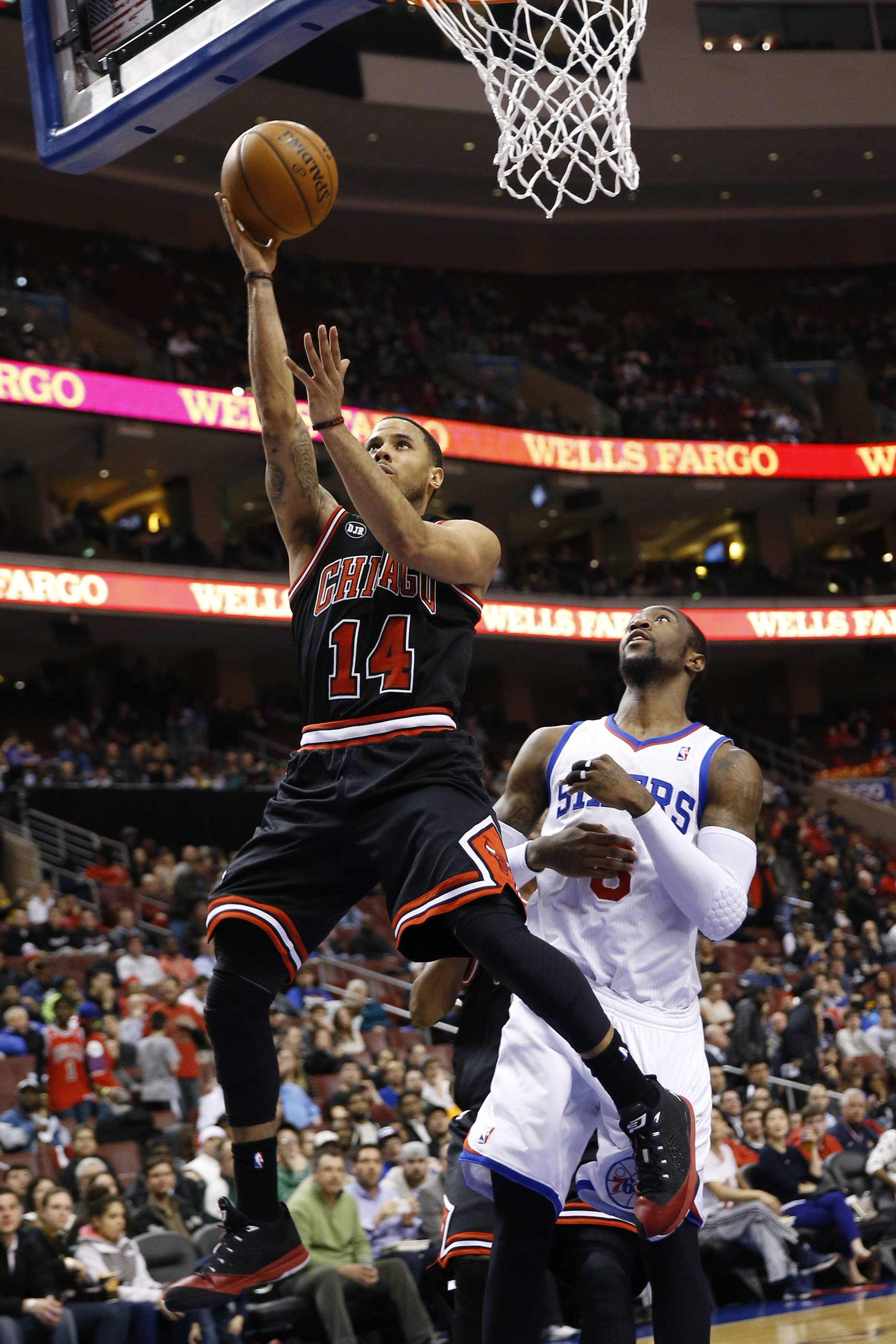 Bulls guard D.J. Augustin goes up for a shot in front of the 76ers' Tony Wroten on Wednesday night. Augustin led the Bulls with 20 points.