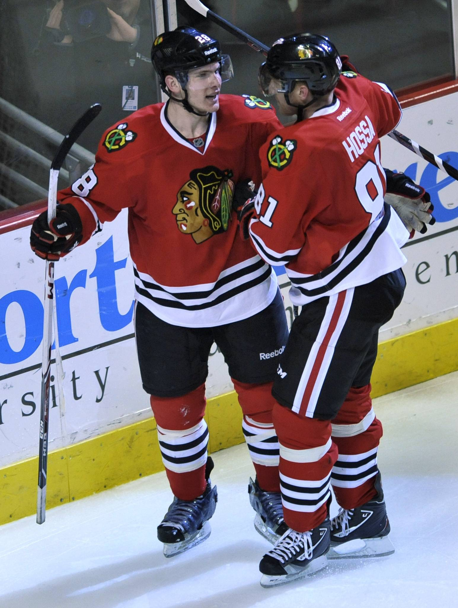 The Blackhawks' Ben Smith (28) celebrates with teammate Marian Hossa after scoring during the third period to make it 4-0 over the Blues on Wednesday night.