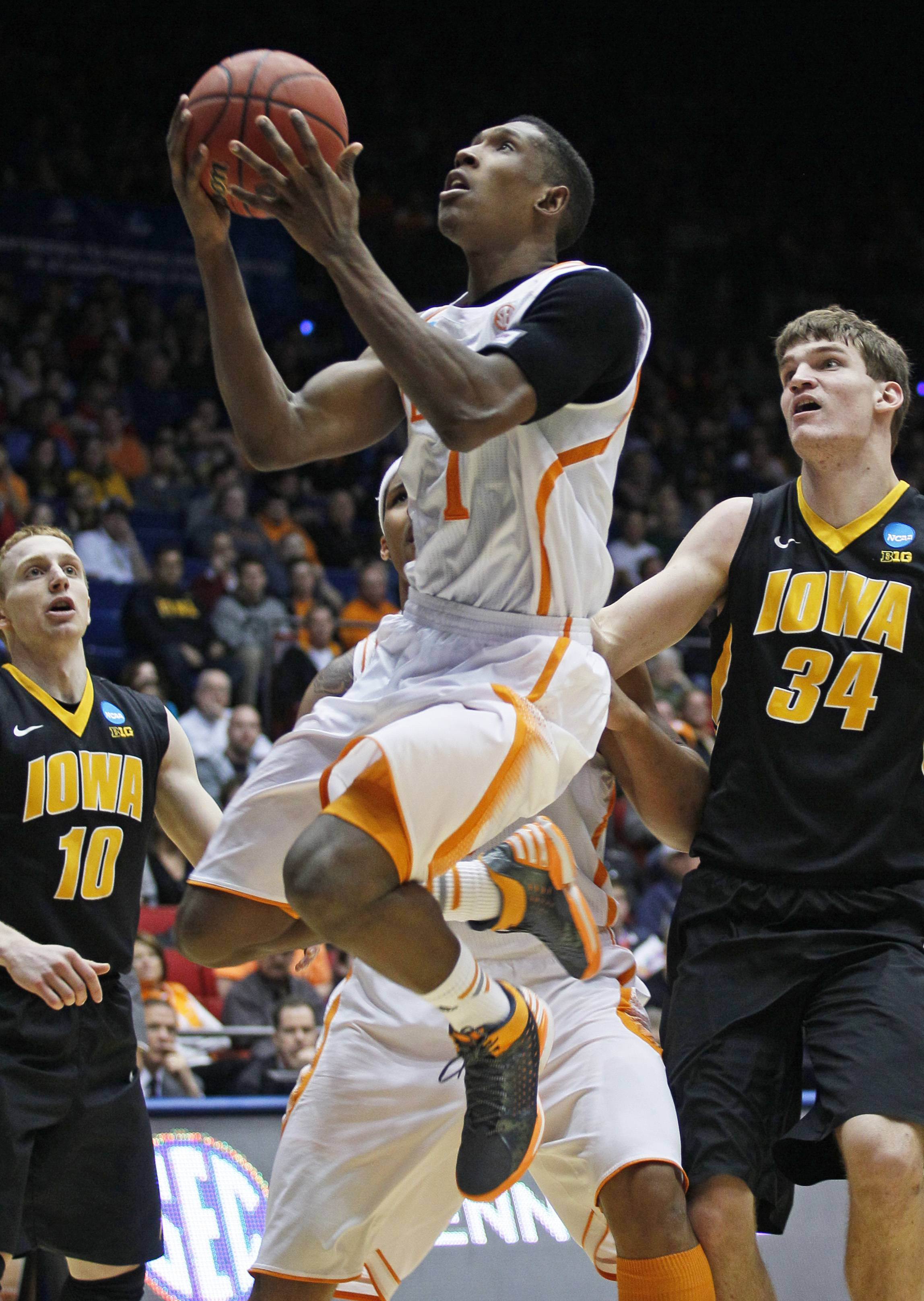 Associated Press Tennessee guard Josh Richardson (1) drives between Iowa guard Mike Gesell (10) and center Adam Woodbury (34) in the second half of a first-round game of the NCAA college basketball tournament on Wednesday in Dayton, Ohio.
