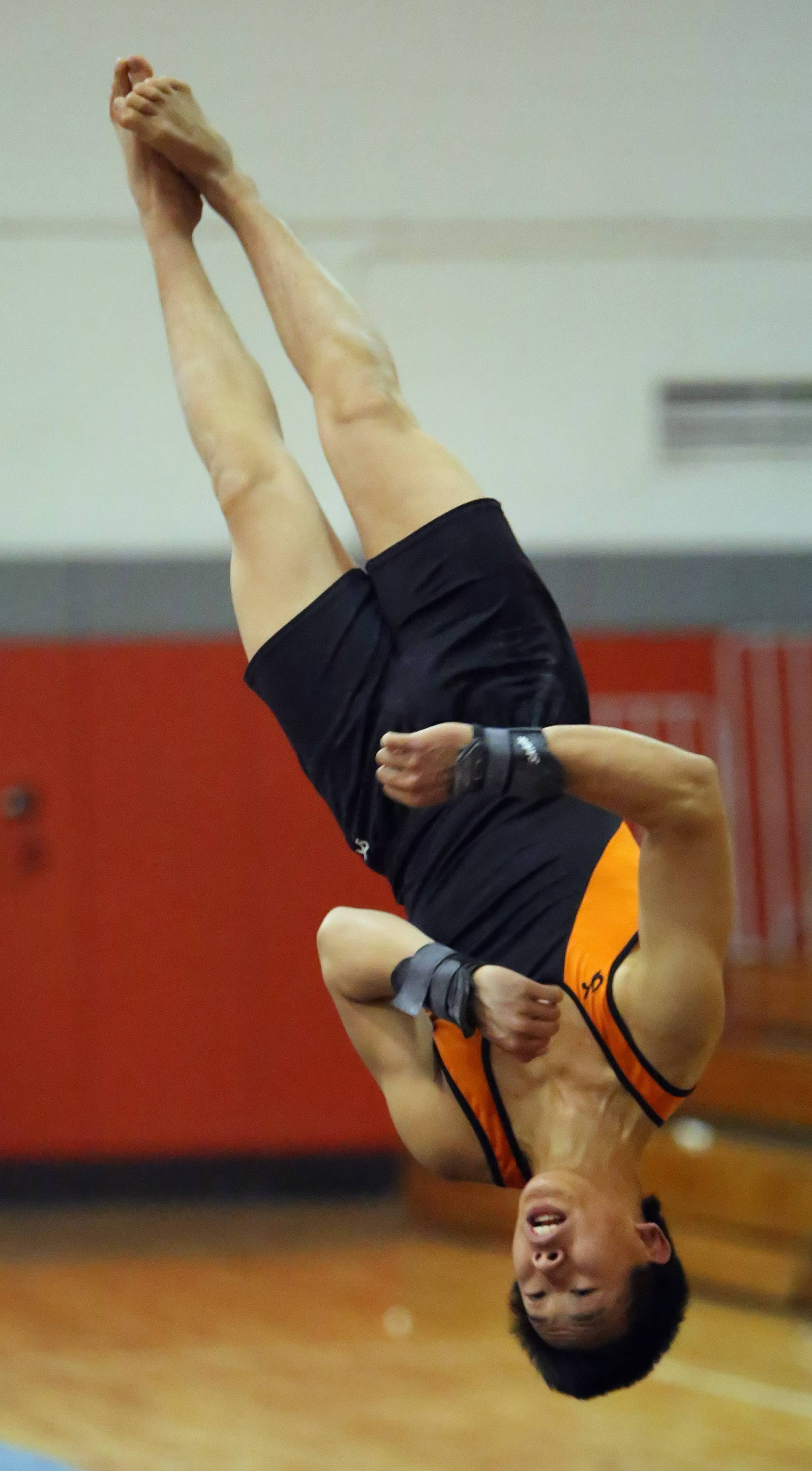 Libertyville's Alex Pong competes on the floor exercise during boys gymnastics action Wednesday night at Mundelein.
