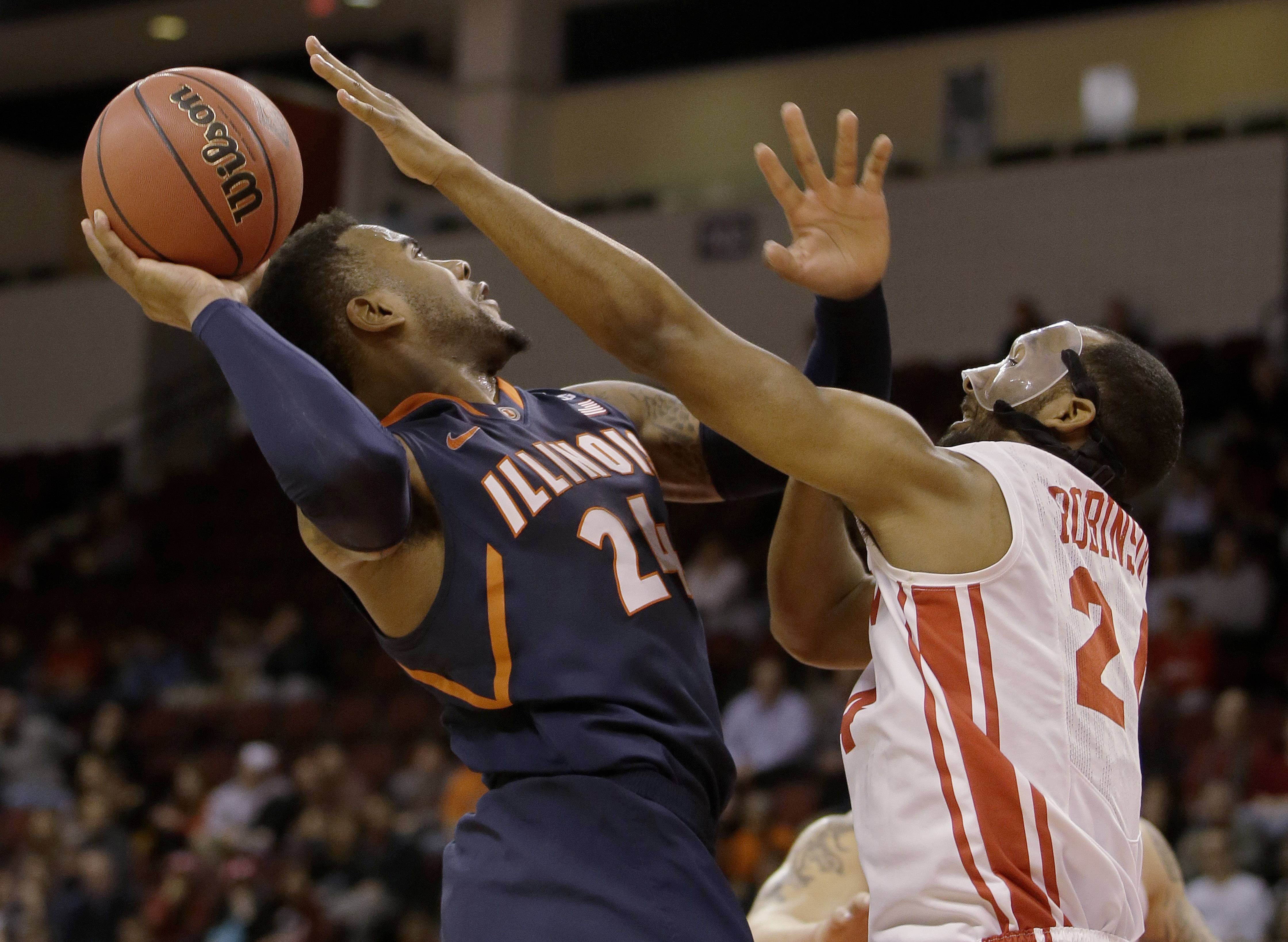 Illinois guard Rayvonte Rice (24) takes the ball to the hoop against Boston University forward Travis Robinson (24)during the second half of their NCAA mens NIT college basketball game Wednesday in Boston. Illinois defeated Boston University 66-62 in a come-from-behind victory late in the second half advancing to the second round of the NIT Tournament.