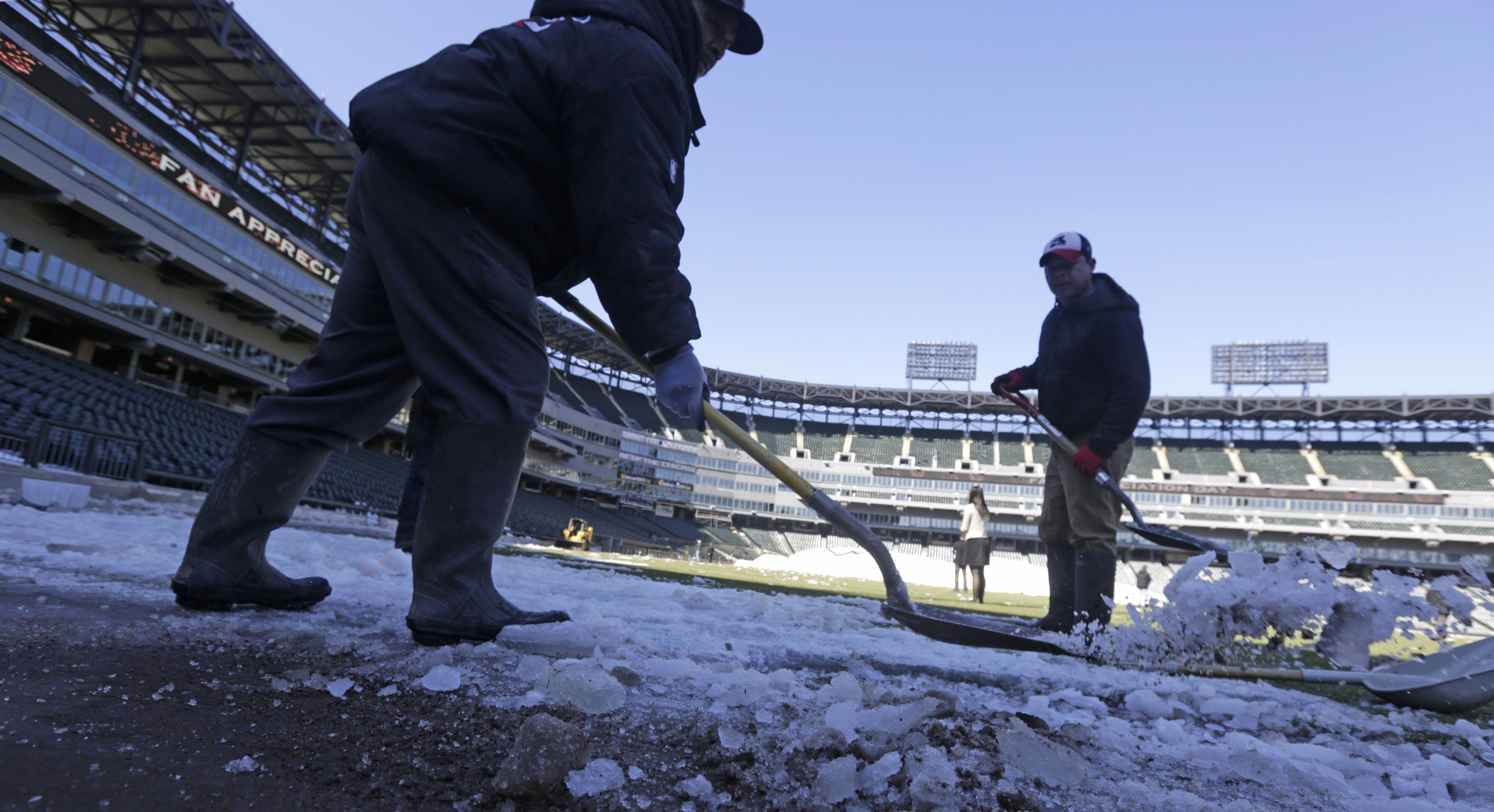 This Monday photo taken in Chicago, shows U.S. Cellular Field, home to the Chicago White Sox baseball team, as members of head groundskeeper Roger Bossard's crew work to ready the field for opening day after one of the most brutal winters the city has ever seen. Brossard described the unusual conditions including 30 inches of permafrost, and having to remove 400 tons of snow from the playing field, as the perfect storm.