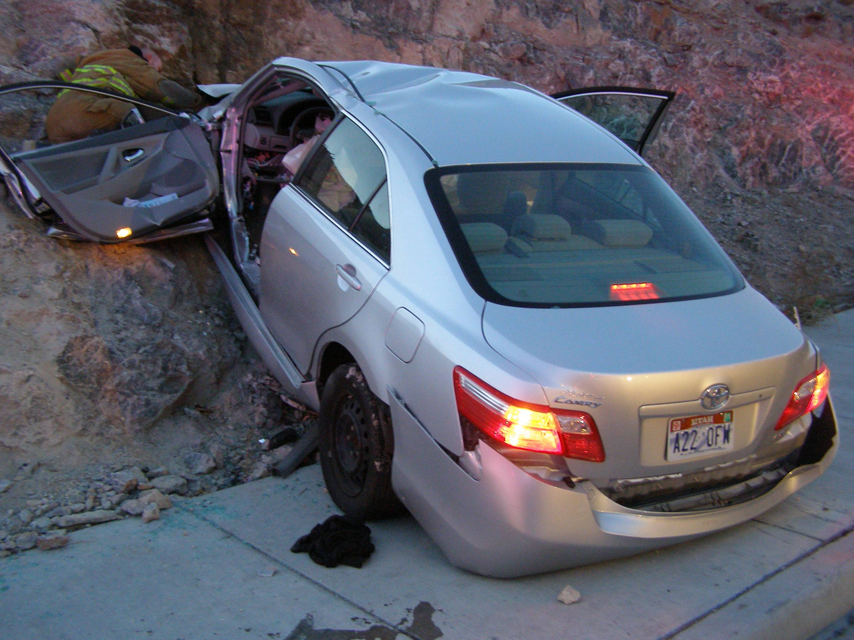 In this Nov. 5, 2010 photo released by the Utah Highway Patrol, a Toyota Camry is shown after it crashed as it exited Interstate 80 in Wendover, Utah. Police suspect problems with the Camry's accelerator or floor mat caused the crash that left two people dead and two others injured.
