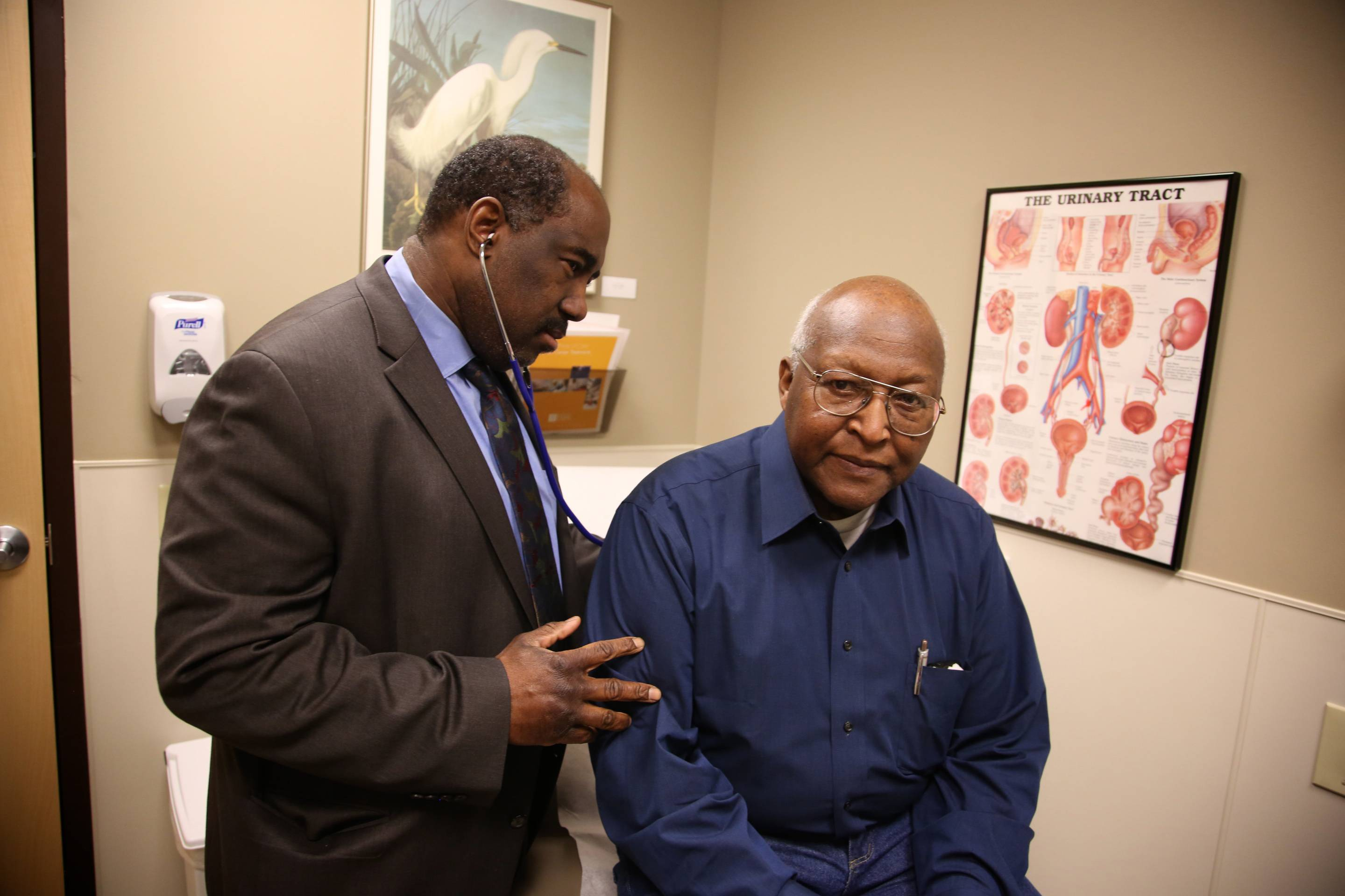 Dr. Willie Underwood, a urologic oncologist at Roswell Park Cancer Institute, examining patient Richard Waldrop at the Roswell Park Cancer Institute, in Buffalo, N.Y.