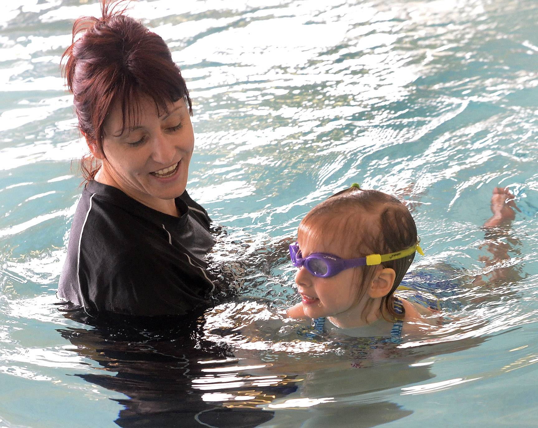 Instructor Eva Kaneva helps 4-year-old Tess Tiedge of Arlington Heights with her swimming at the Chicago Swim School in Arlington Heights.