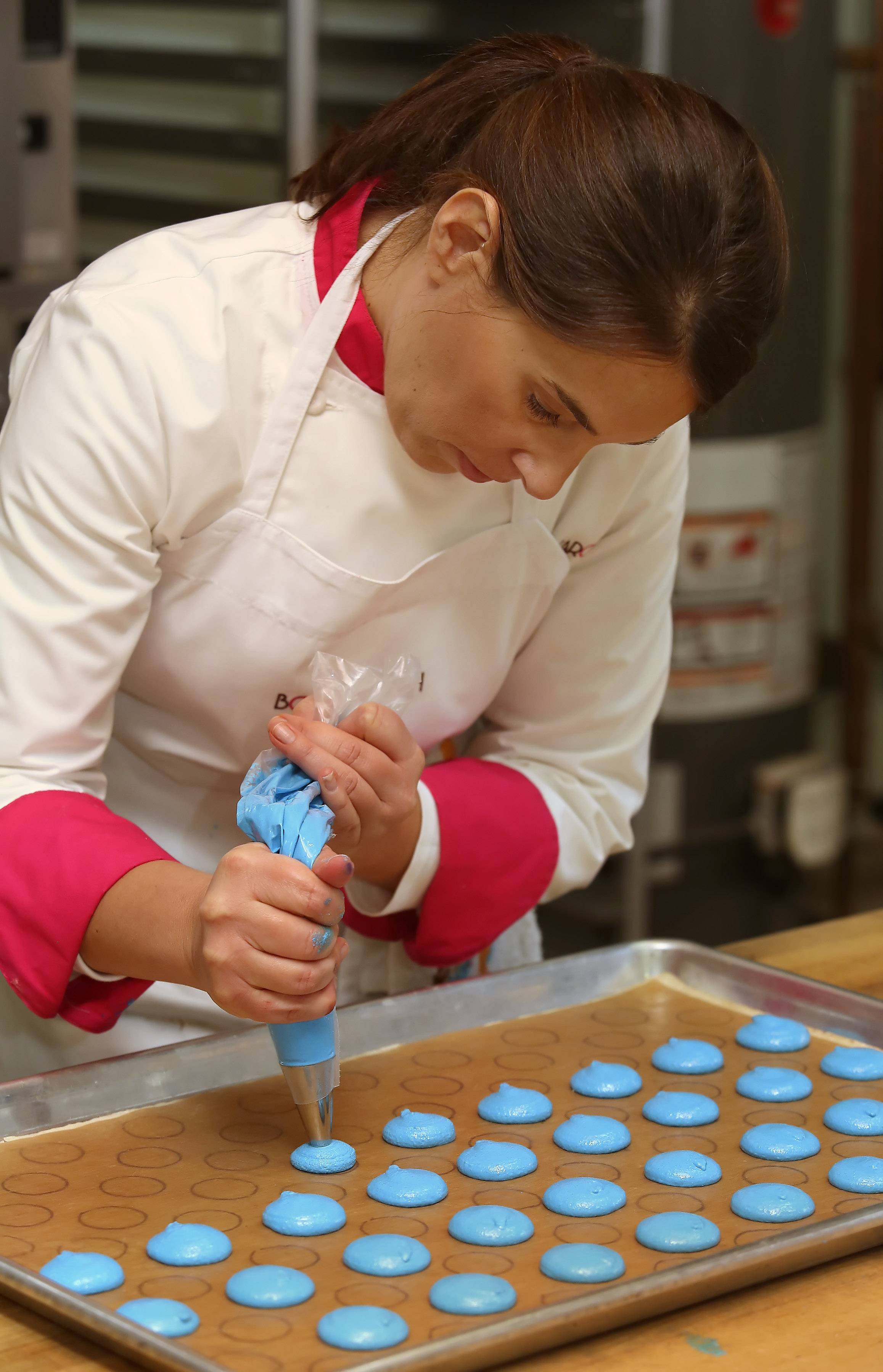 Barrington native Catherine Cooper of Bon Macaron Chicago makes the delicate French treat called macarons at Kitchen Chicago.