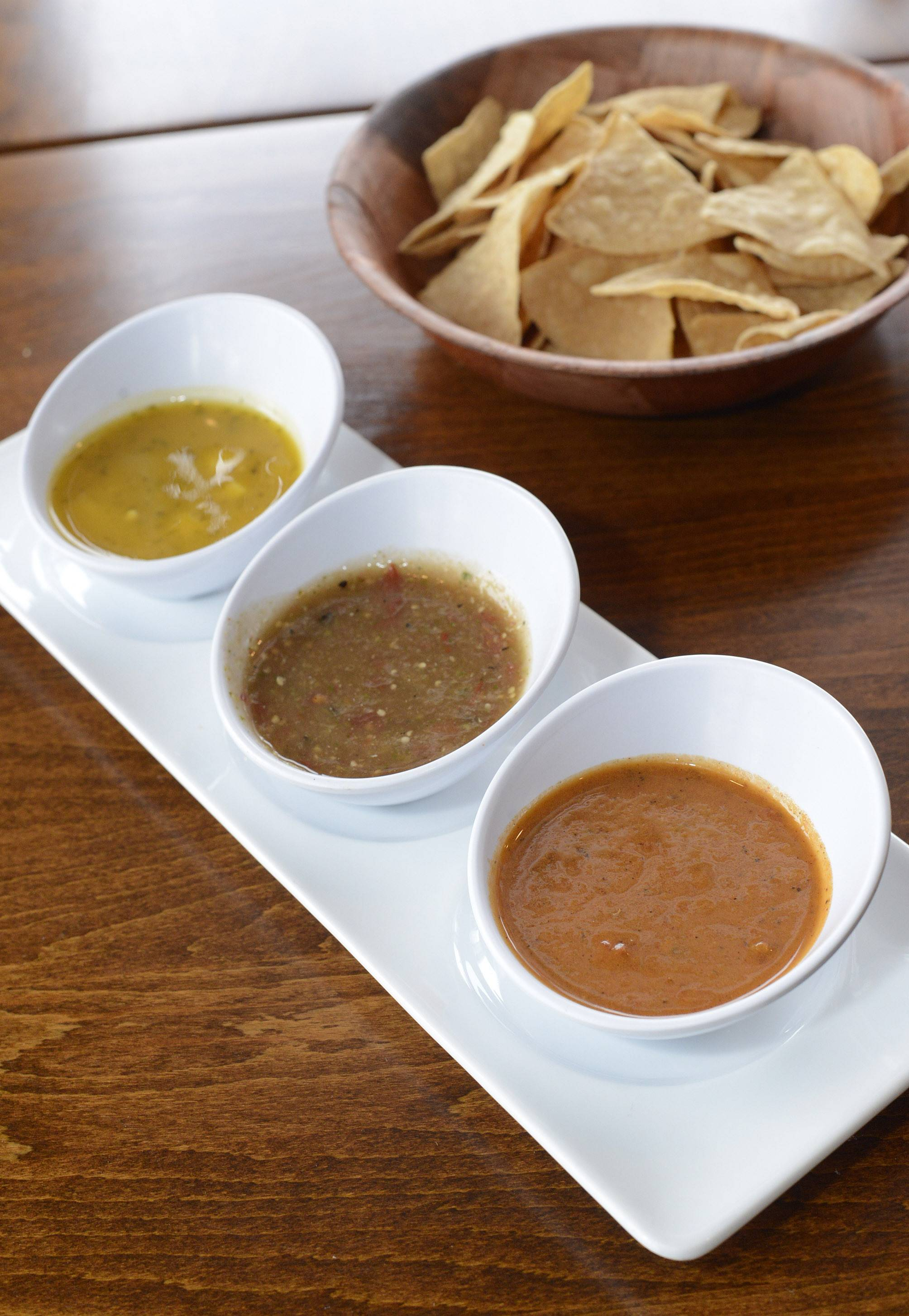 Cactus Zone serves chips with a trio of salsas, from left, mango cilantro (mild), tomatillo crudo (medium) and cuatro chiles (hot).