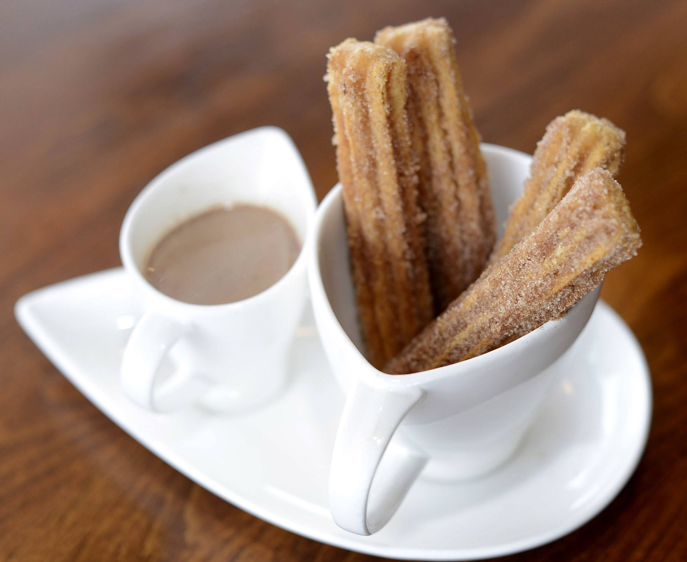 Homemade churros sprinkled with sugar and cinnamon are served with Mexican hot chocolate at Cactus Zone in Sleepy Hollow.
