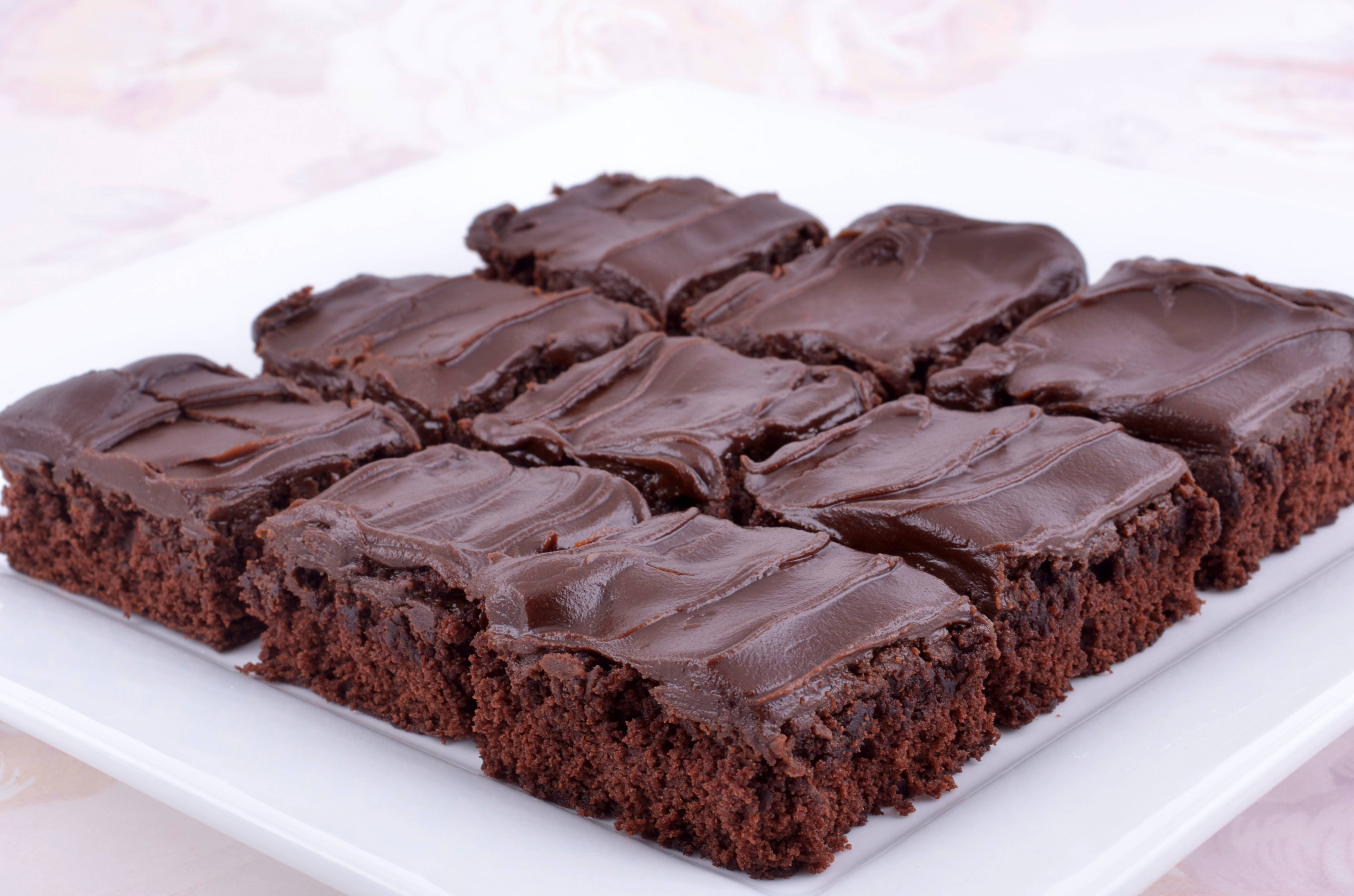 Cinnamon and cayenne pepper perk up chocolate brownies; the sweet ganache frosting counteracts the heat.