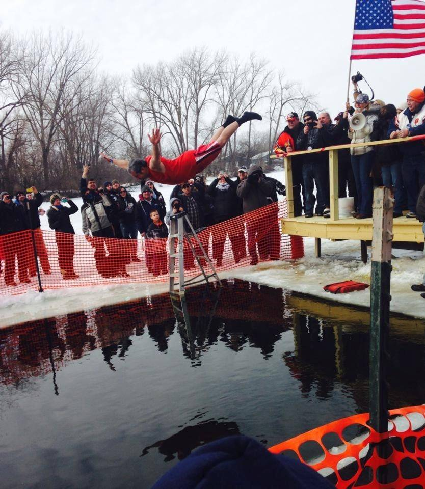 A jumper belly flops during the Broken Oar's Fox River Shiver fundraiser.
