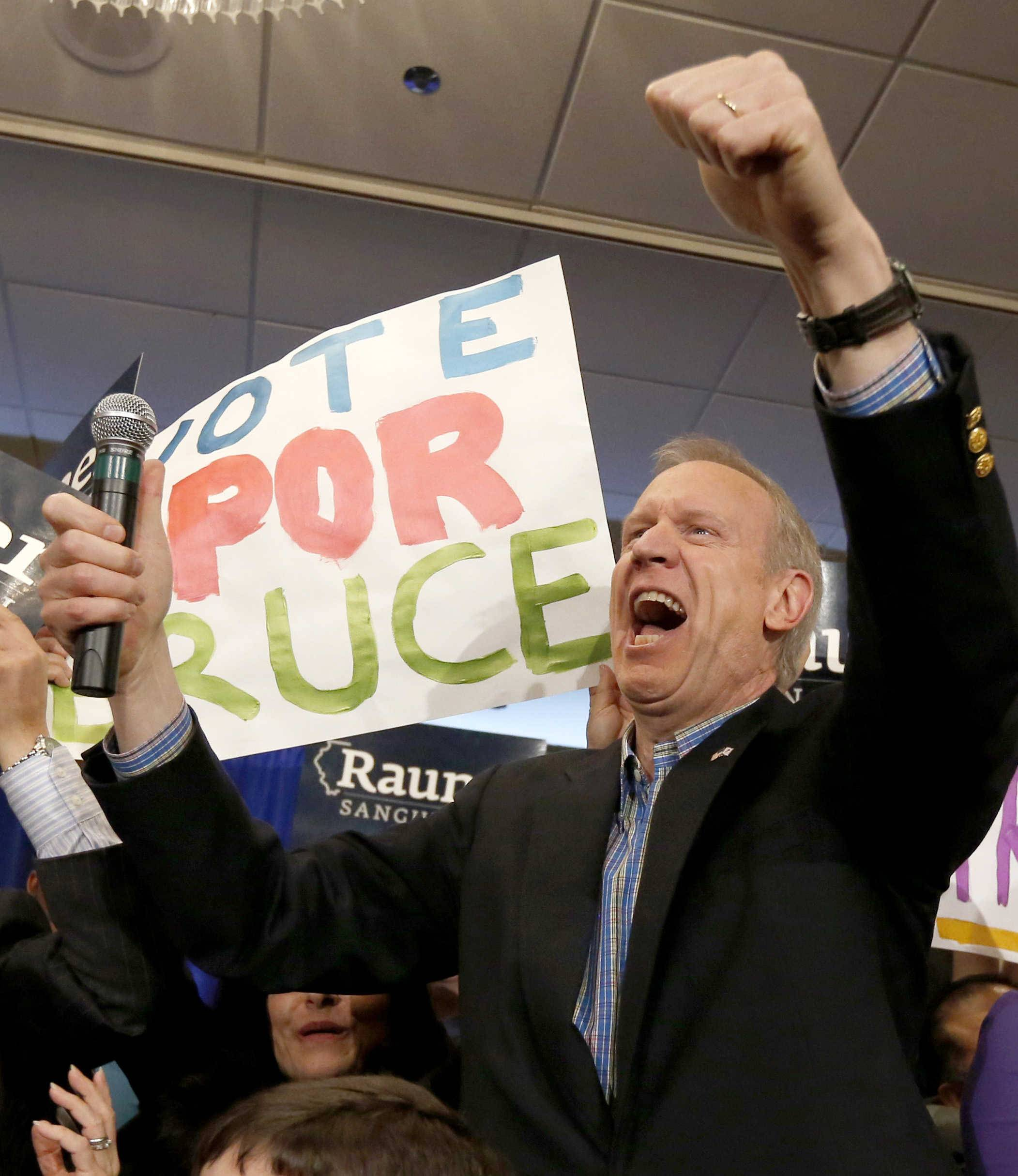 Businessman Bruce Rauner, left, and his wife Diana celebrate with supporters after he won the GOP nomination for governor.