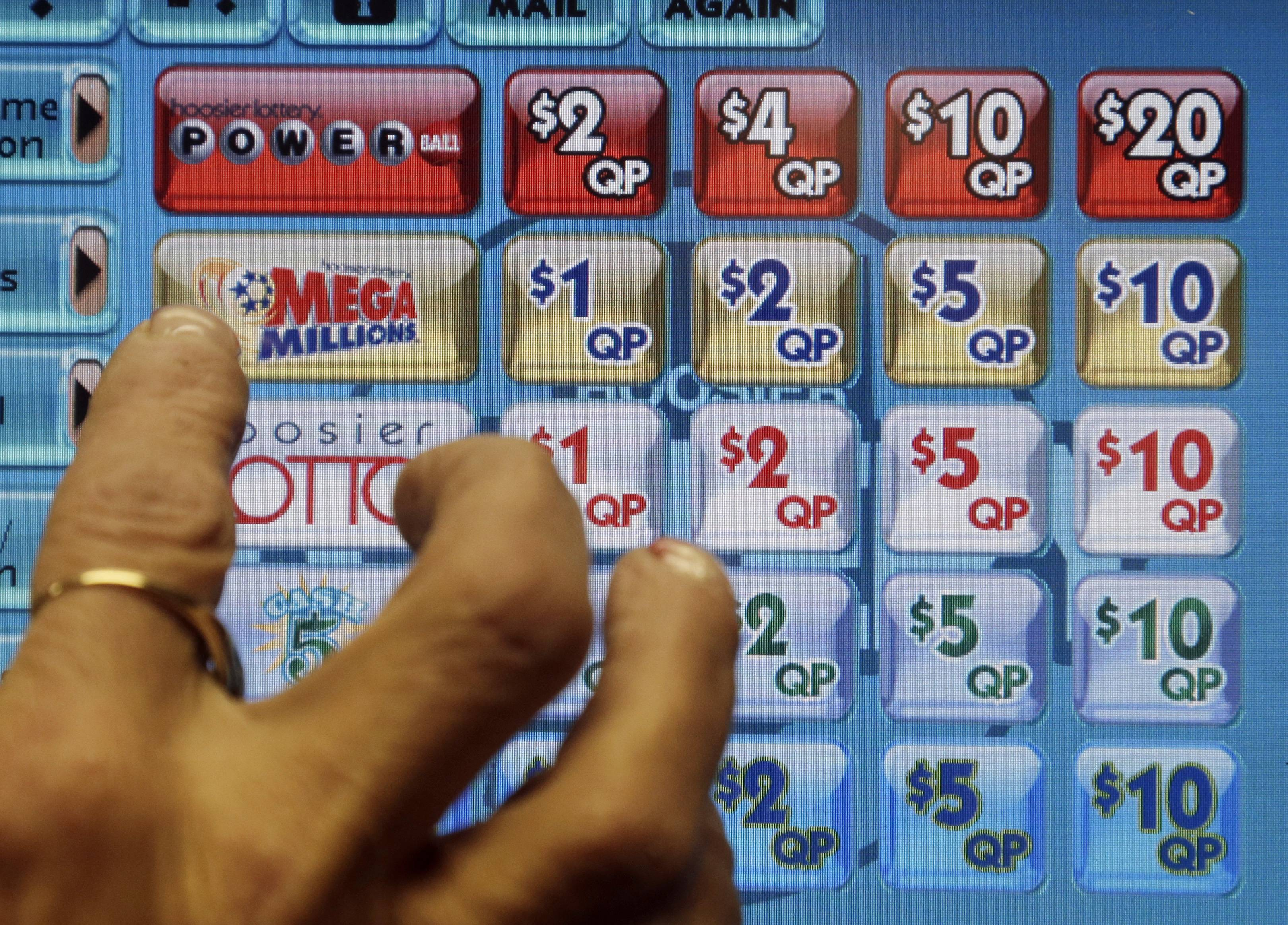 Two tickets -- one sold at a Sunoco convenience store on Florida's Space Coast, the other at a liquor store southeast of Washington in La Plata, Md. -- matched all six winning numbers in the Tuesday night drawing: 11, 19, 24, 33 and 51 with a Mega Ball of 7.