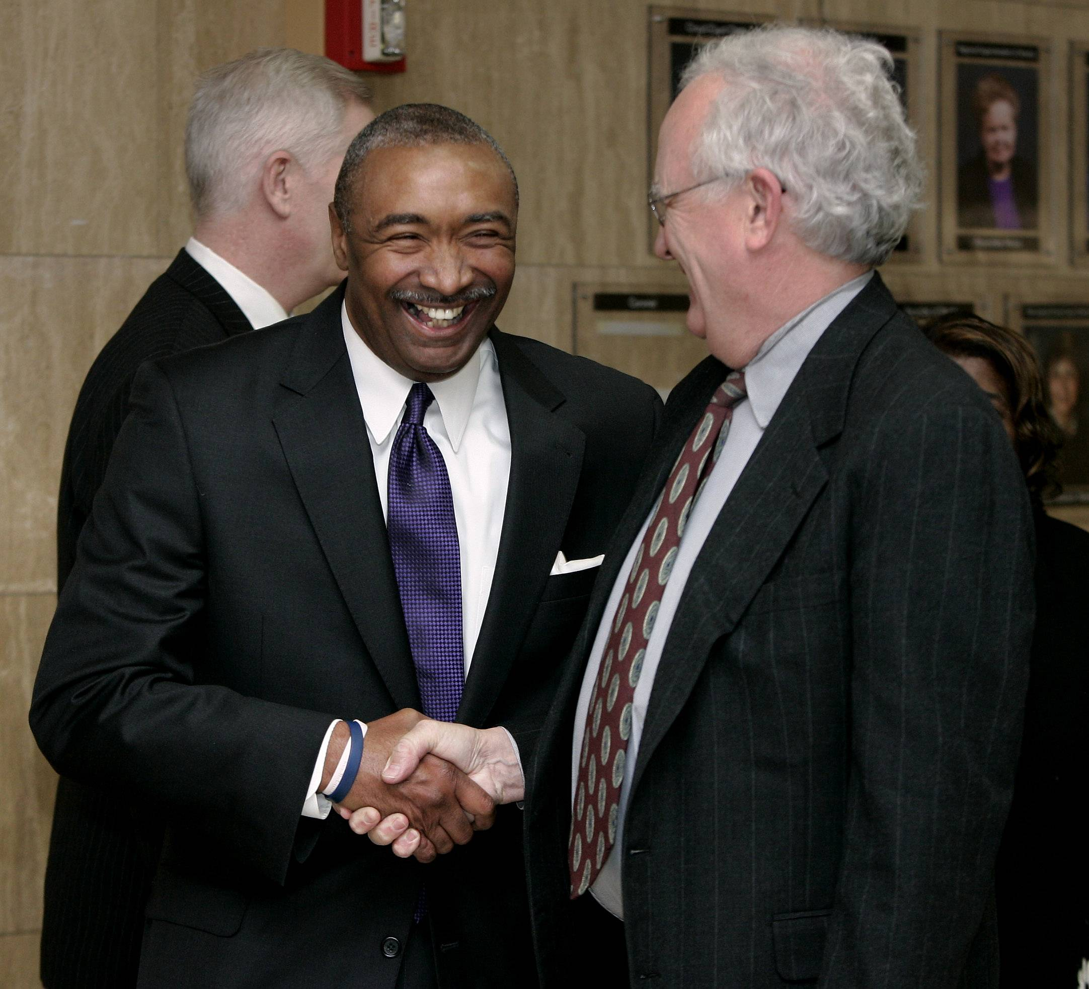 Artis Yancey, left, with former Lake County State's Attorney Michael Waller after Yancey was named Lake County coroner in 2011.