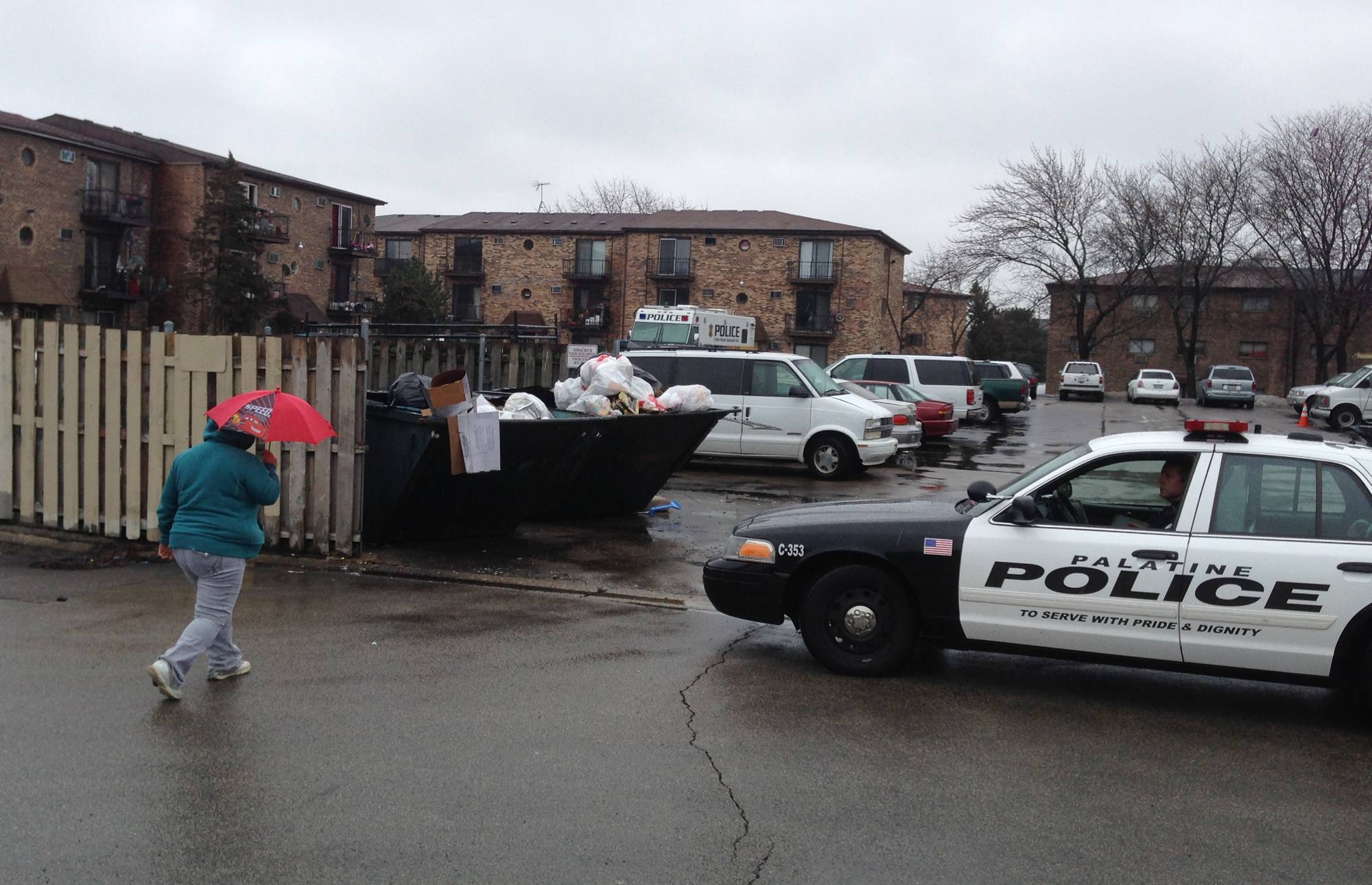 Palatine police were posted at the Baldwin Green Apartments Wednesday as investigators searched for answers in the fatal shootings of a 15-year-old boy and his 38-year-old father shortly after midnight.
