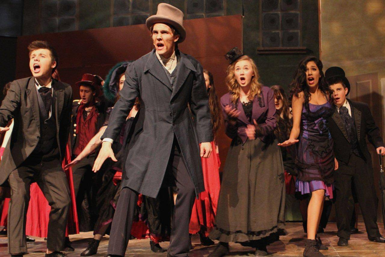 "Rian Kormos, center, plays Danvers in Geneva High School's production of ""Jekyll & Hyde."""