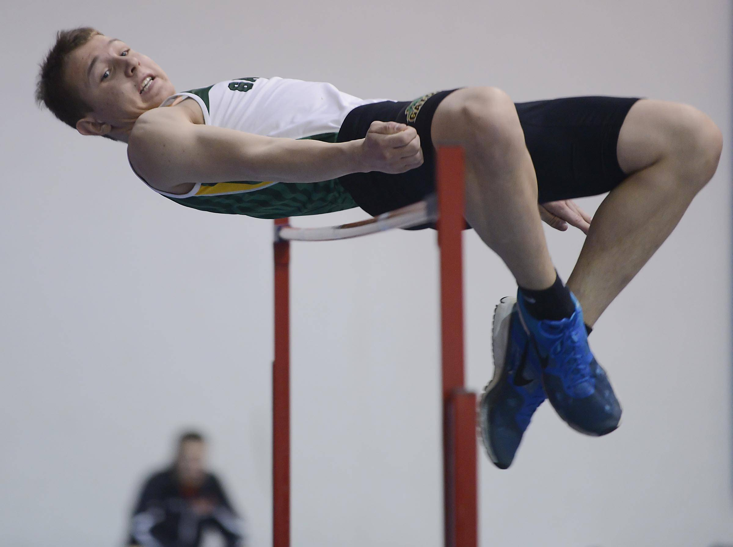 Crystal Lake South's Dan Rastenis competes in the high jump Wednesday at the Fox Valley Conference boys indoor track meet at Dundee-Crown High School in Carpentersville.