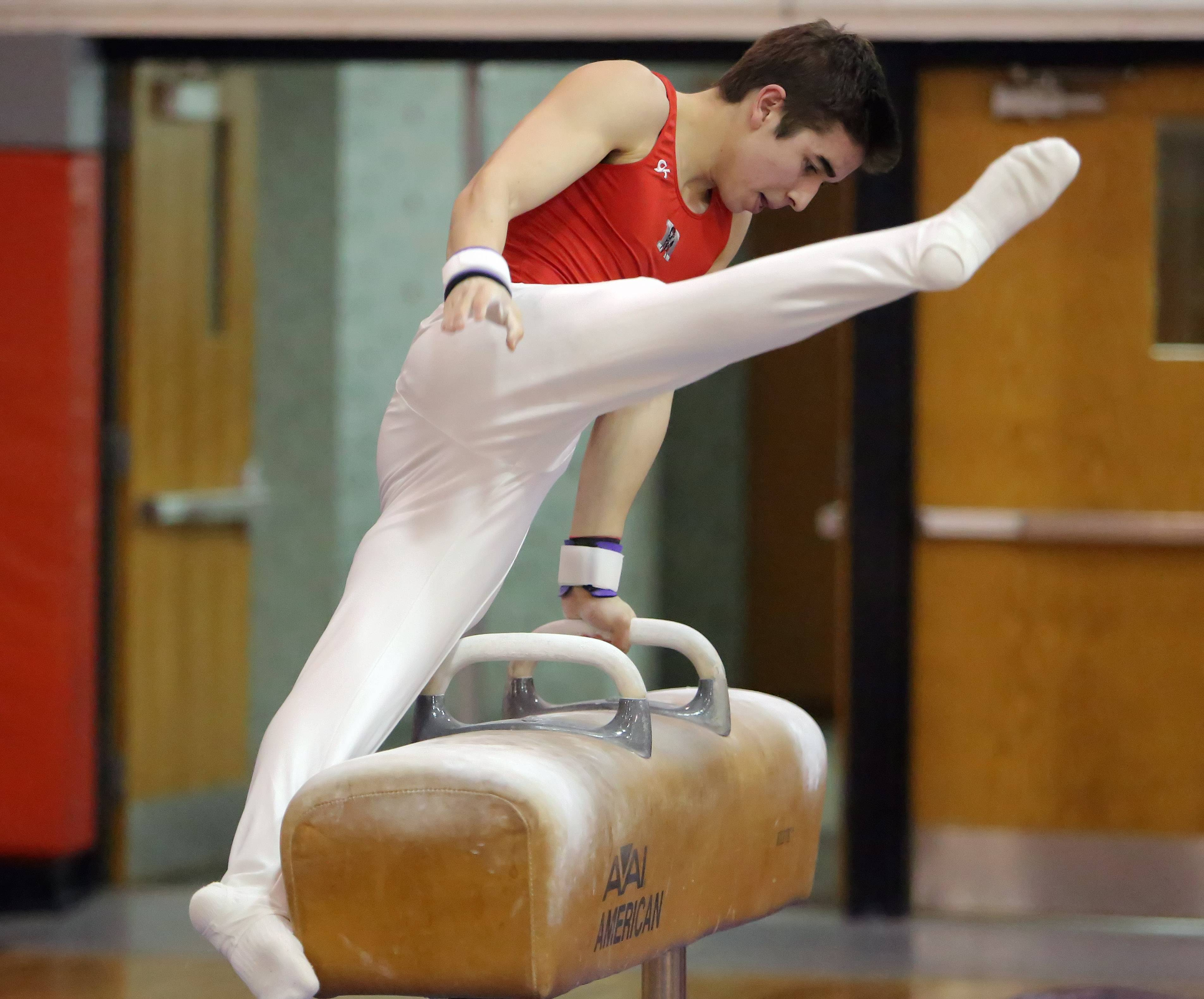 Mundelein's Colin McCarthy competes on the pommel horse during boys gymnastics action Wednesday night at Mundelein.