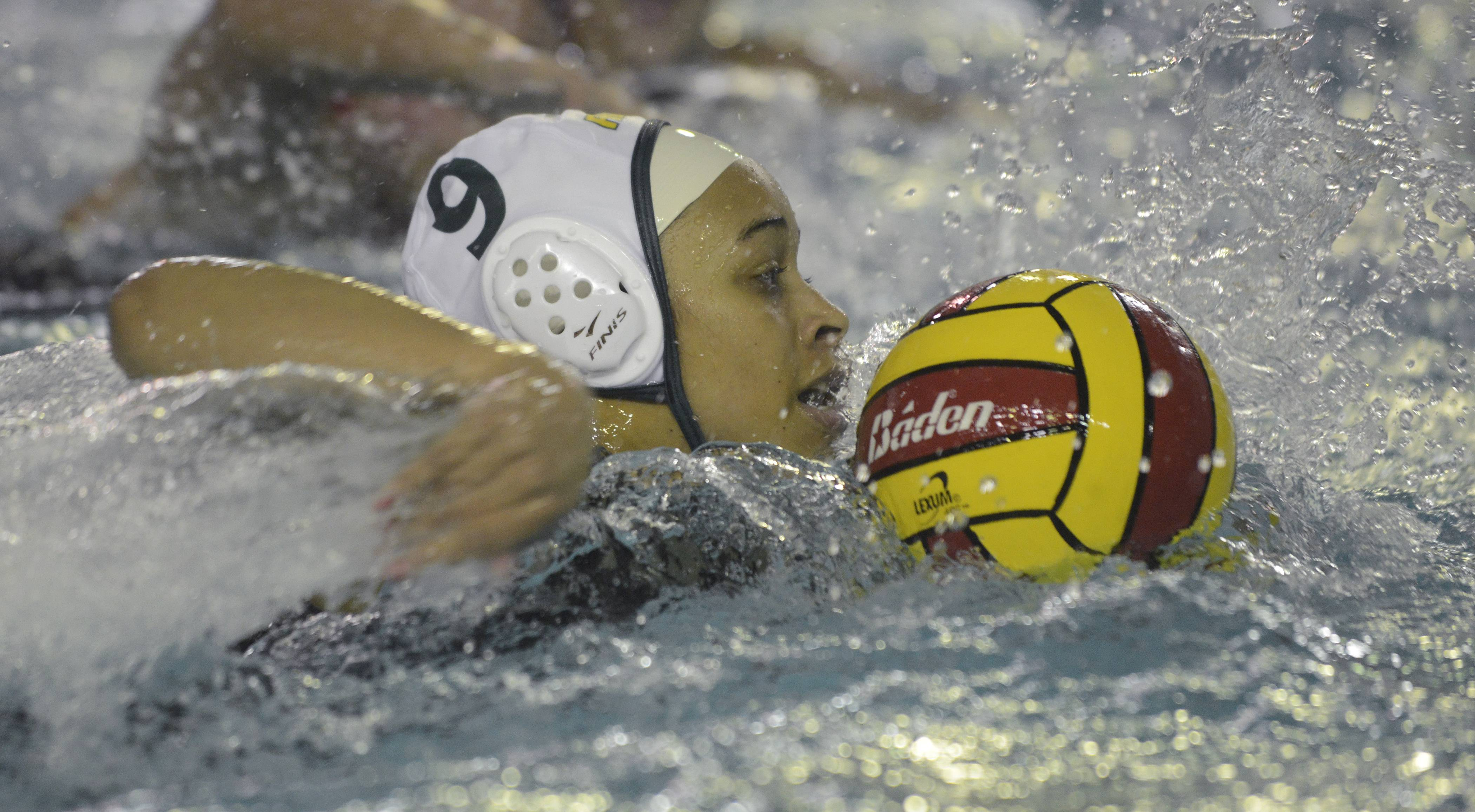 Fremd's Nicole Degla leads a fastbreak during Wednesday's water polo game at Palatine.