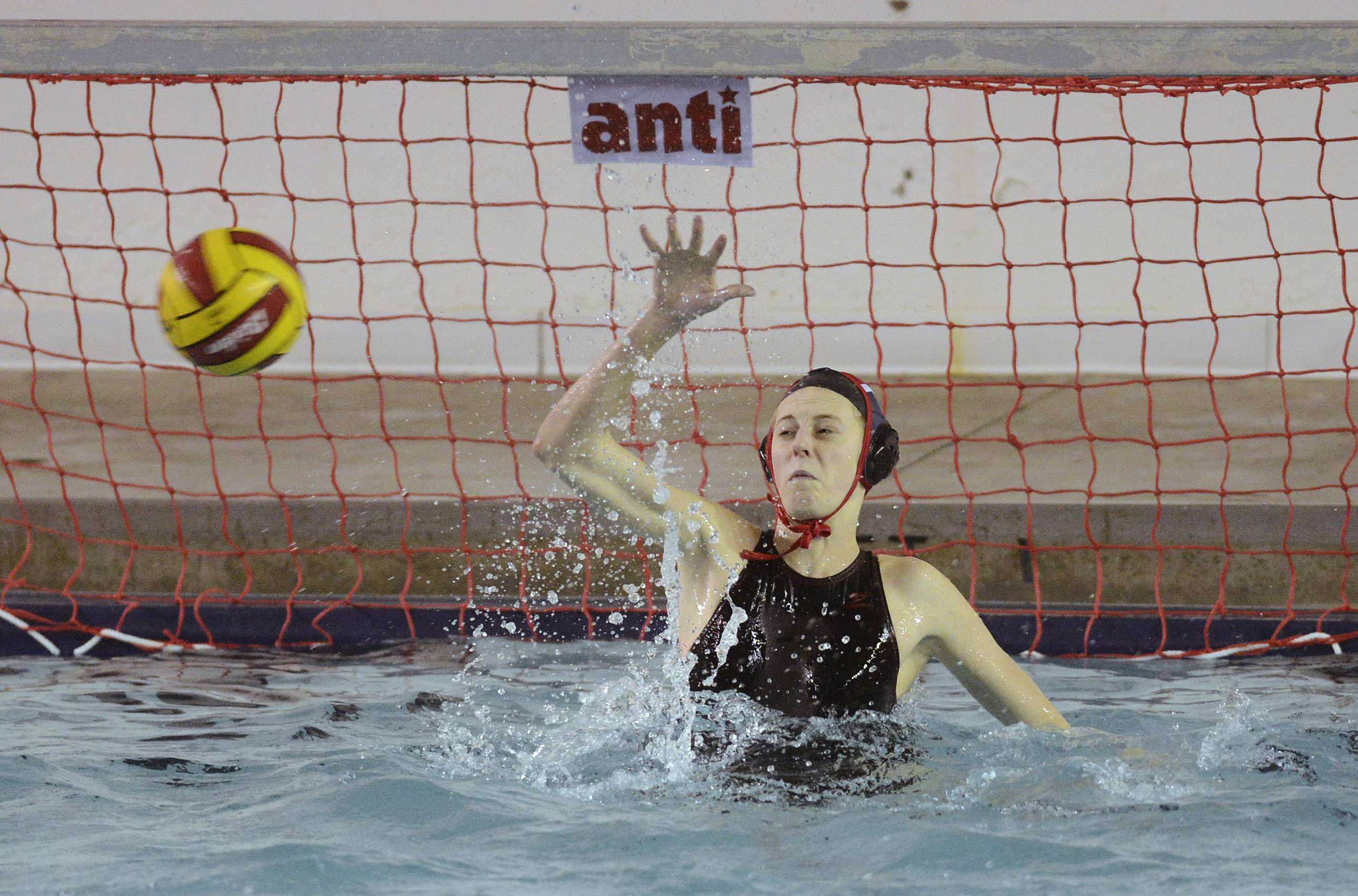 Palatine goalie Kim Butler makes a save during Wednesday's water polo game against Fremd.