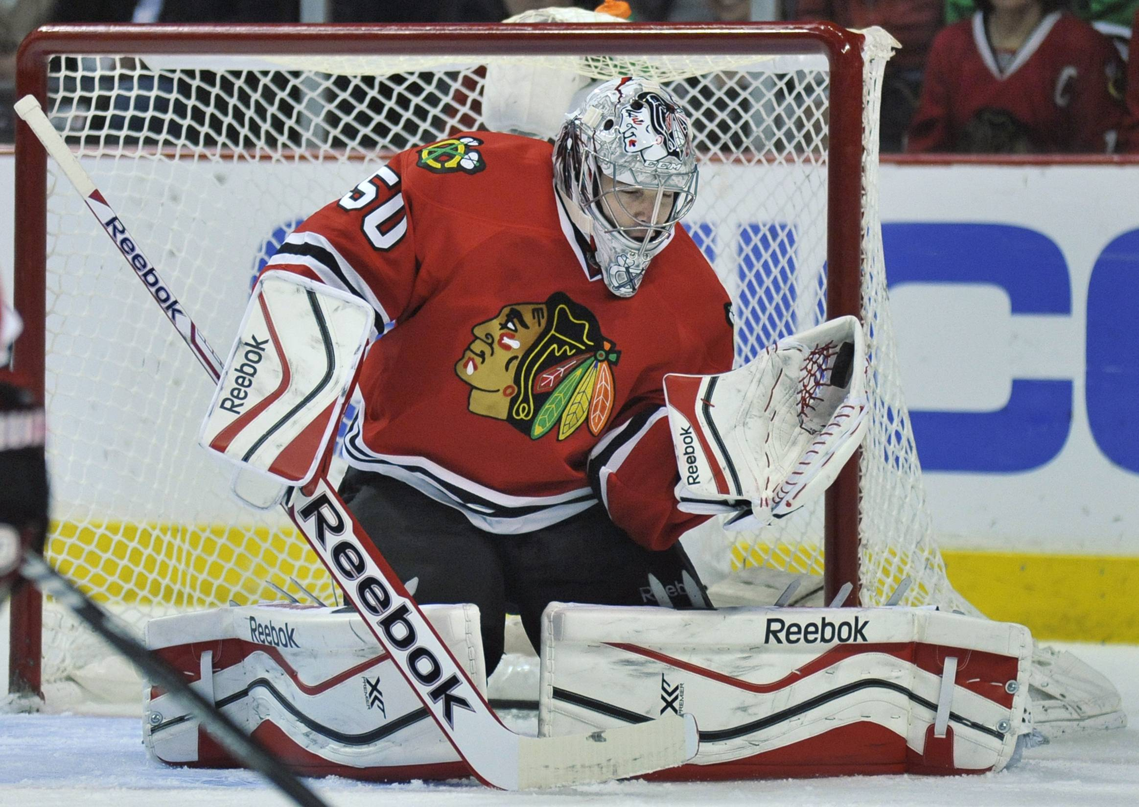 Chicago Blackhawks goalie Corey Crawford makes a save during the first period of an NHL hockey game Wednesday against the St. Louis Blues in Chicago. The Blackhawks would go on to win 4-0.