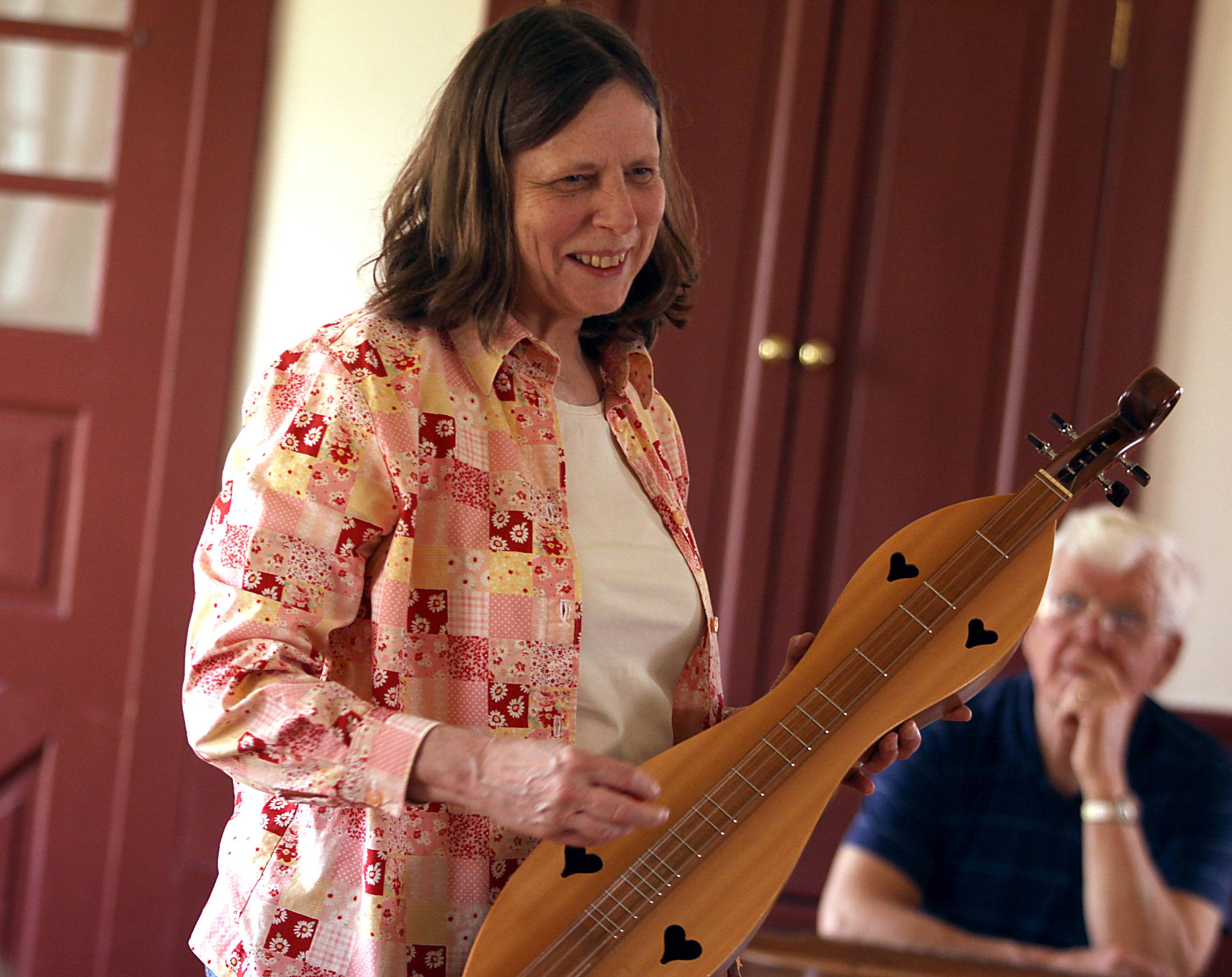 Dona Benkert of the Folk-Lore Center music school of Warrenville introduces the history of the mountain dulcimer during a previous dulcimer workshop at Garfield Farm Museum in Campton Hills.
