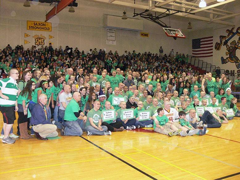 Schaumburg High School student and staff participants in the St. Baldrick's event gather after they had their heads shaved or their hair cut.