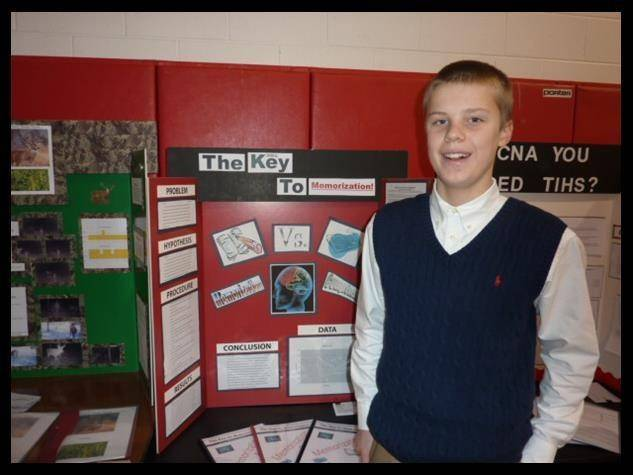 St. Anne student Matthew Doersching stands with his Gold Award science project.