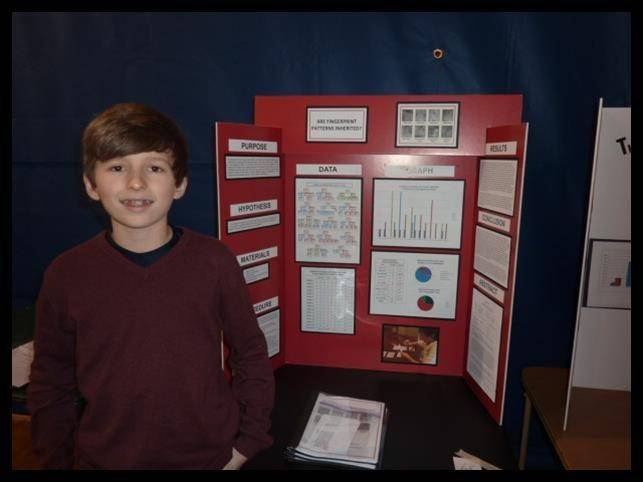 St. Anne student Grant Jodoin stands with his science project that takes him to the state competition at Northern Illinois University in May.