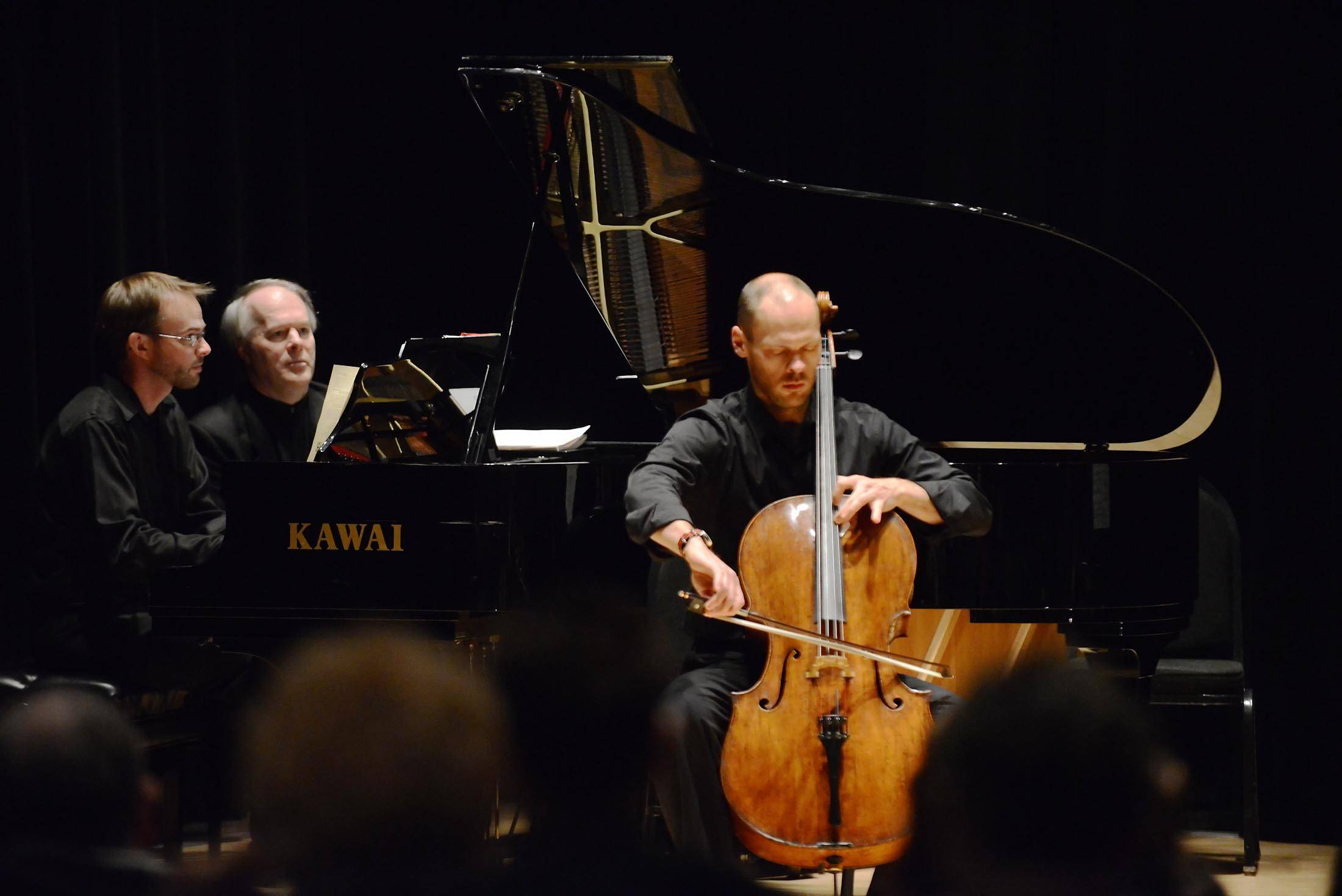 Brant Taylor plays the cello as the Elgin Youth Symphony Orchestra faculty raises funds through a recital at Elgin Community College. David Anderson accompanies him on piano.