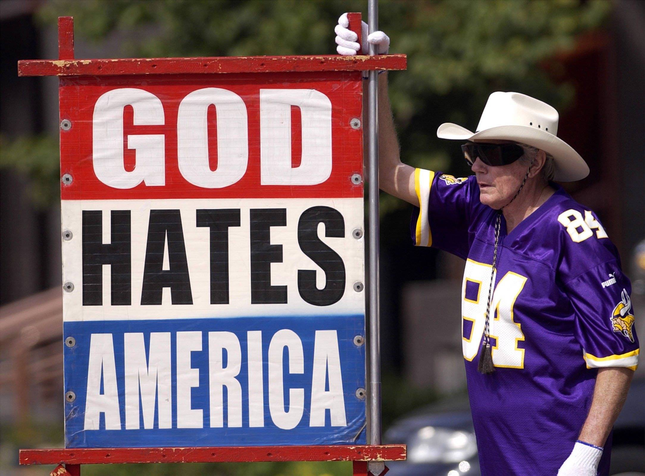 Fred Phelps Sr. displays one of his many infamous protest signs. Phelps, the fiery founder of the Westboro Baptist Church, a small Kansas church, who drew international condemnation for outrageous and hate-filled protests that blamed almost everything, including the deaths of AIDS victims and U.S. soldiers, on America's tolerance for gay people, died Thursday. He was 84.