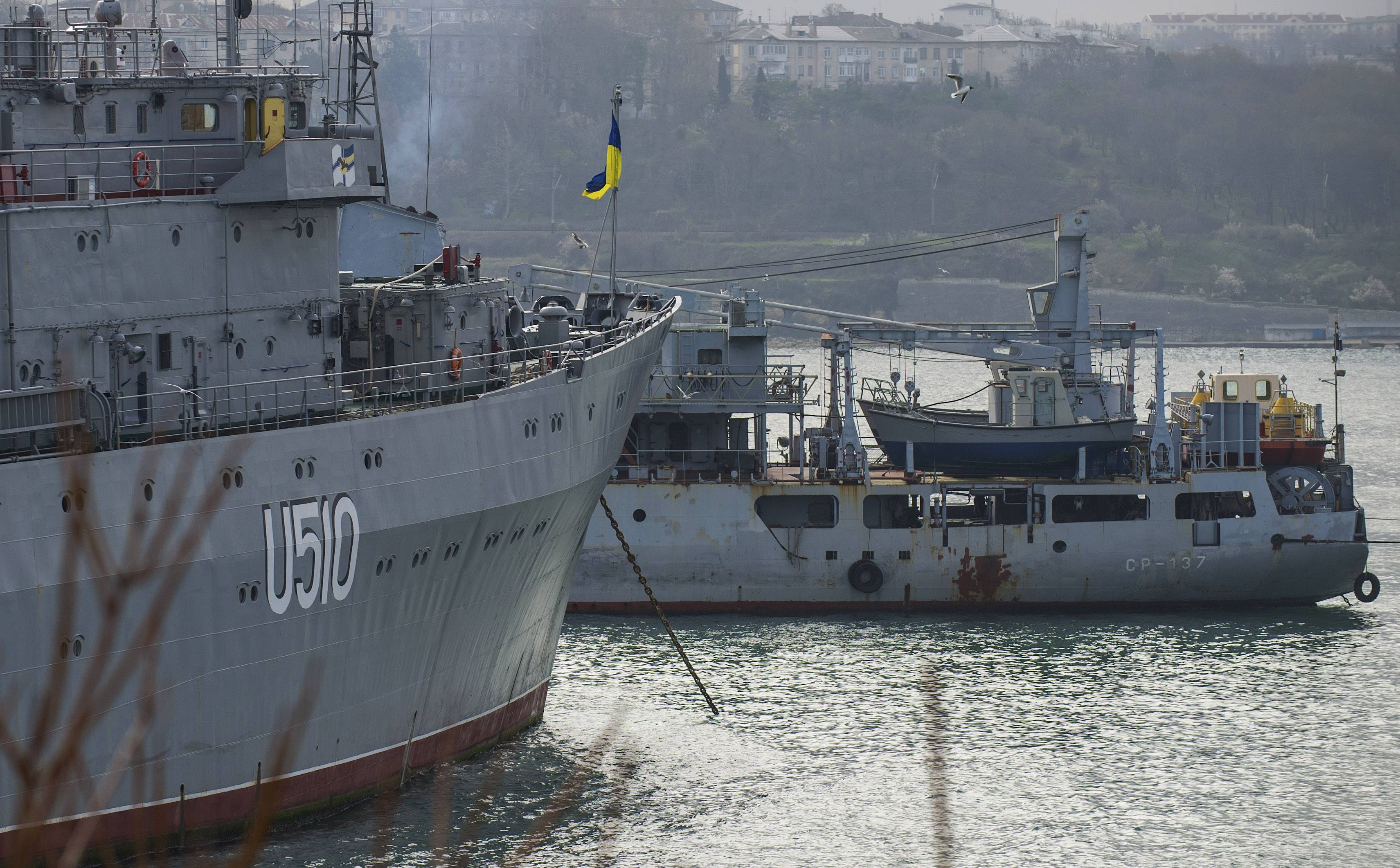 Russian naval vessel bottles up Ukrainian ship Slavutich, left, at her mooring in Sevastopol, Crimea, on Thursday, March 20, 2014.