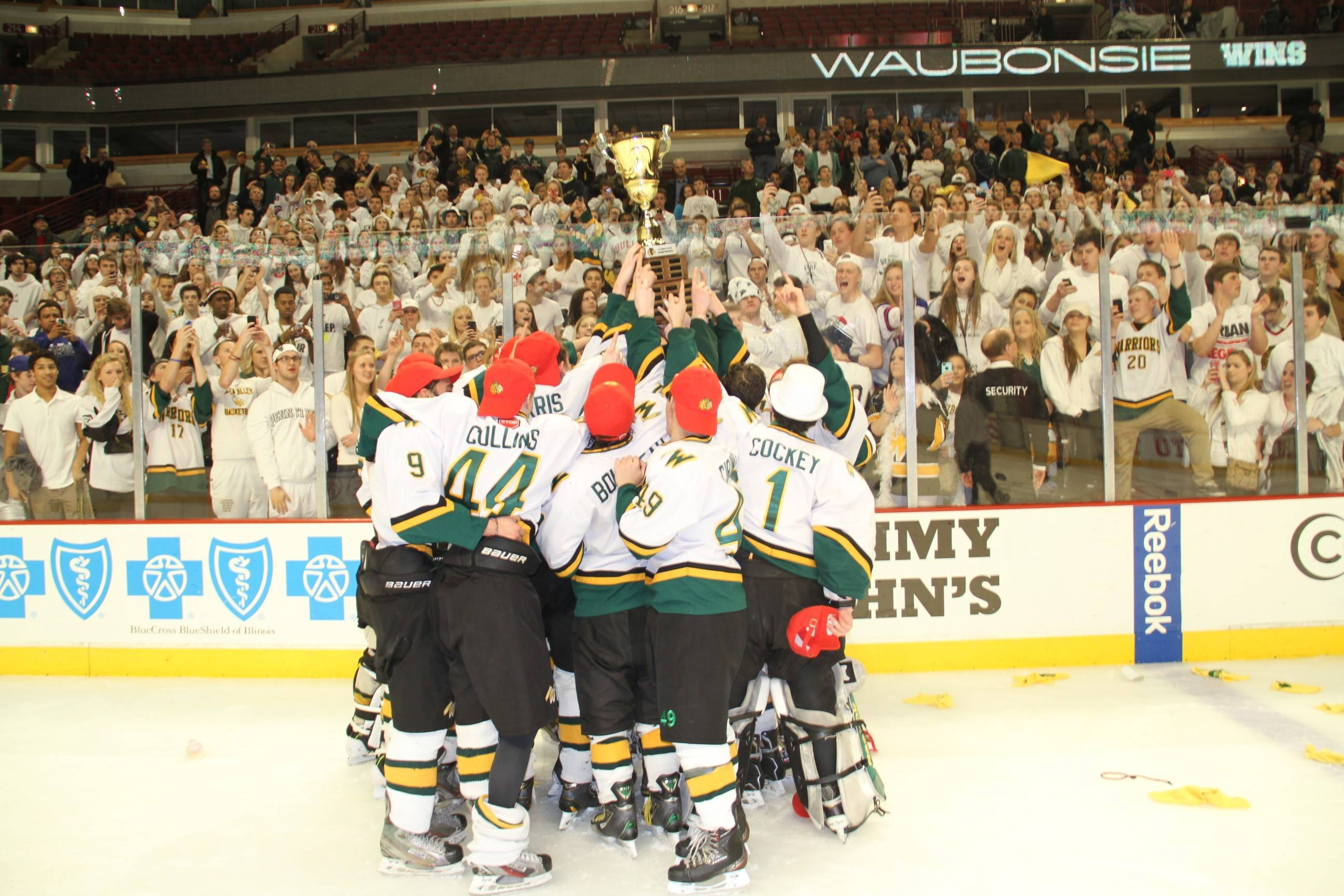 Waubonsie hockey players display the Combined Division state championship trophy after a 3-0 victory over Glenbard on Thursday at the United Center.