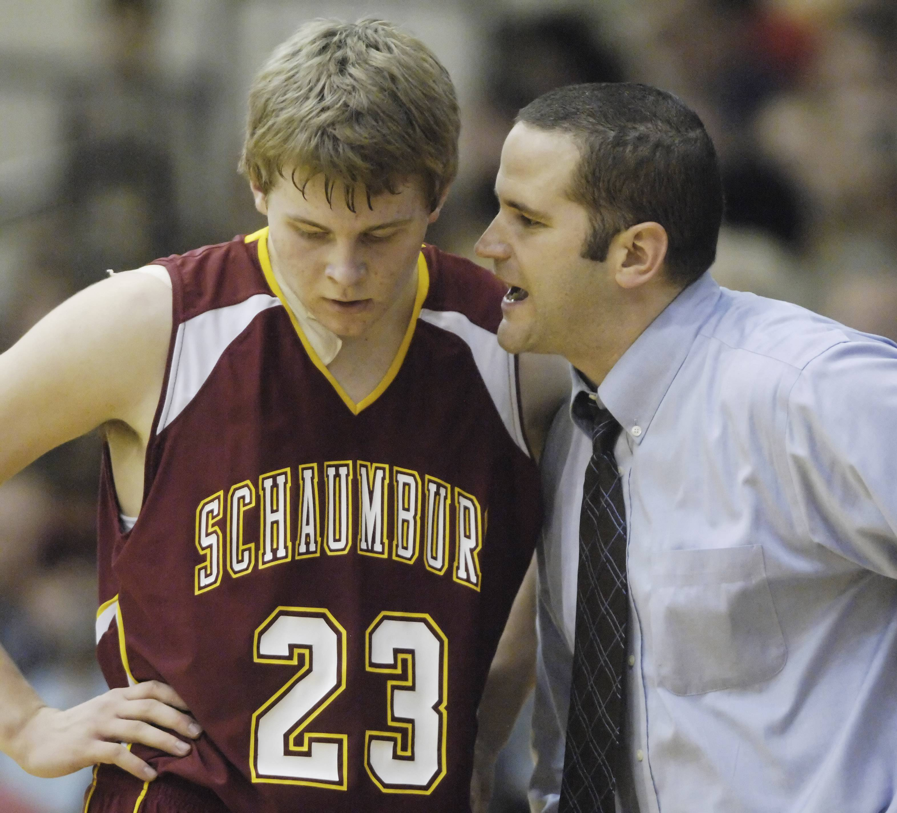 Coach Matt Walsh talks to Schaumburg's Kyle Bolger during sectional semifinal play against Oak Park-River Forest in 2012.