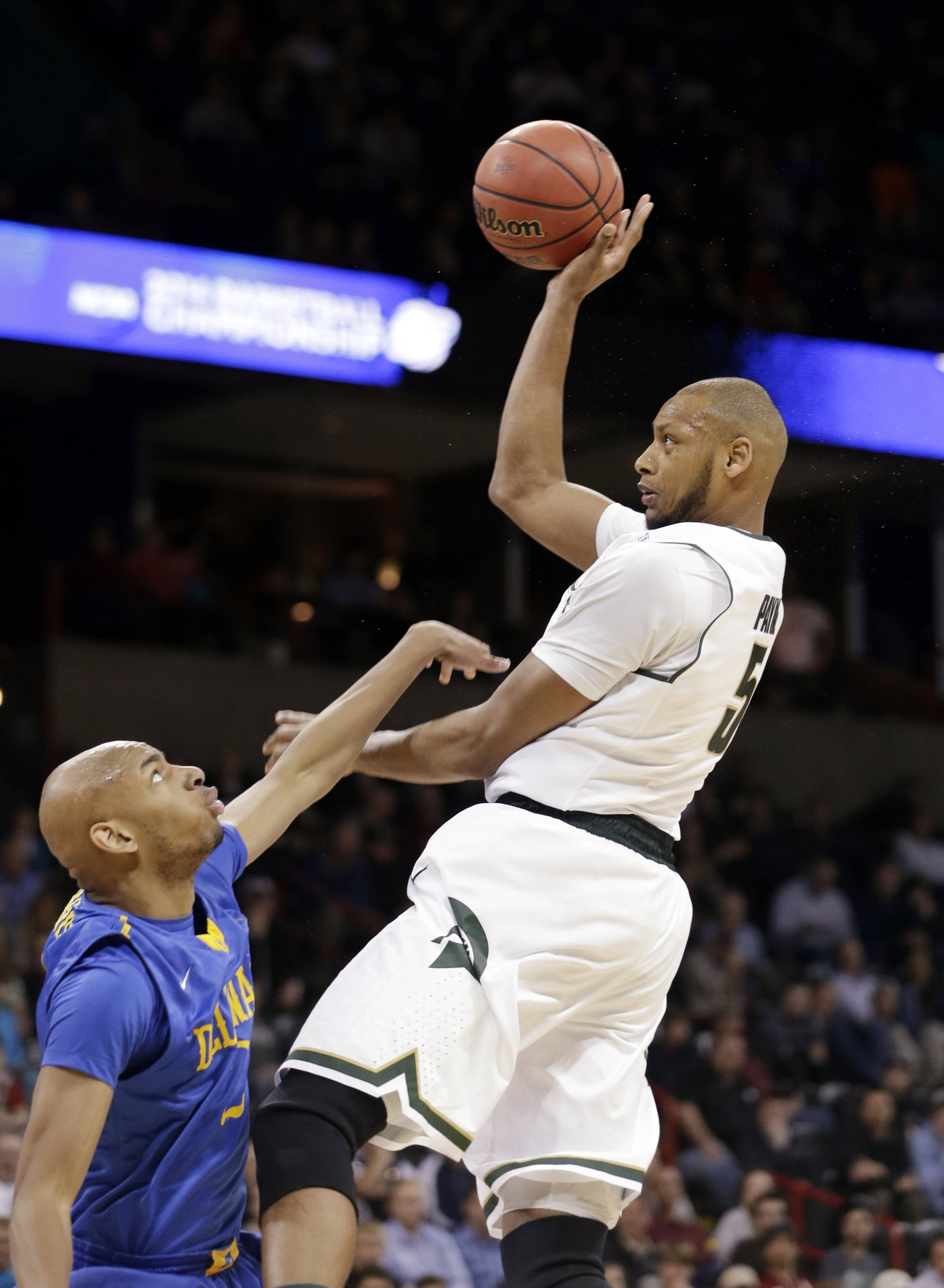 Michigan State's Adreian Payne, right, shoots over Delaware's Barnett Harris in the second half during the second round of the NCAA college basketball tournament in Spokane, Wash., Thursday, March 20, 2014. Michigan State won 93-78. (AP Photo/Elaine Thompson)