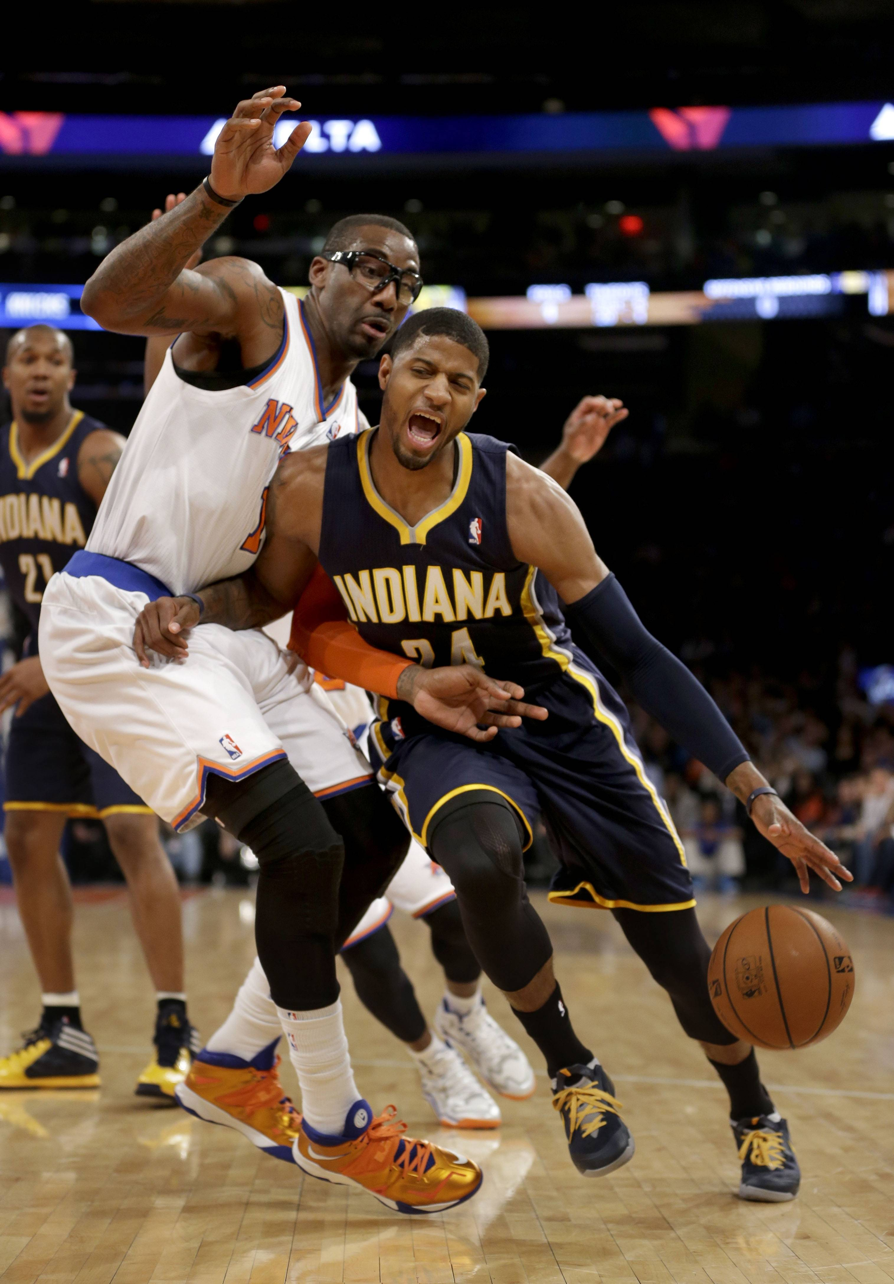 Associated Press Indiana Pacers' Paul George, right, pushes past New York Knicks' Amare Stoudemire during the first half at Madison Square Garden.