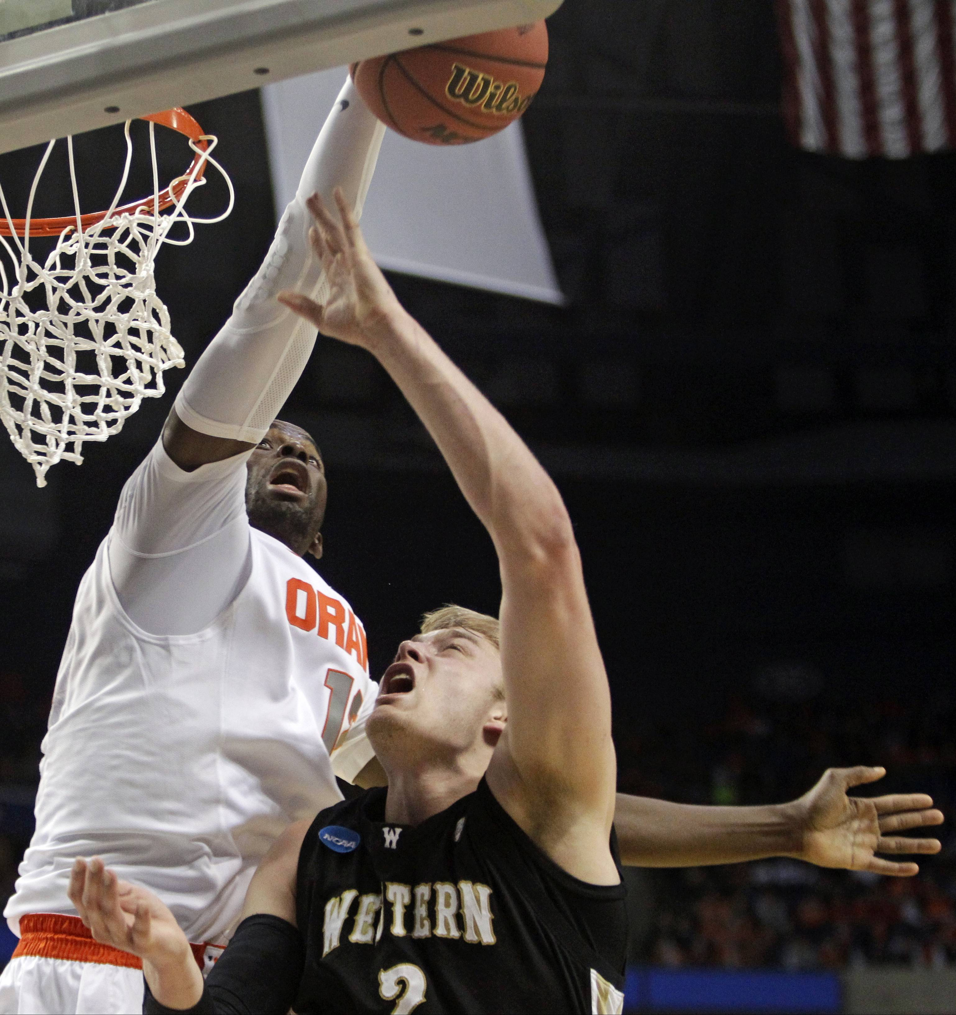 Syracuse's Baye-Moussa Keita, left, blocks a shot by Western Michigan's Connar Tava during the second half of a second-round game in the NCAA college basketball tournament in Buffalo, N.Y., Thursday, March 20, 2014. (AP Photo/Bill Wippert)